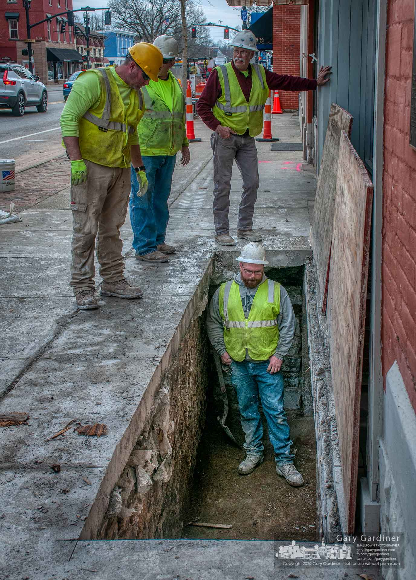 Construction workers inspect the Uptown Pharmacy basement that extended under the sidewalk in Uptown after removing the sidewalk as part of the Uptown Improvement project. My Final Photo for March 9, 2020.