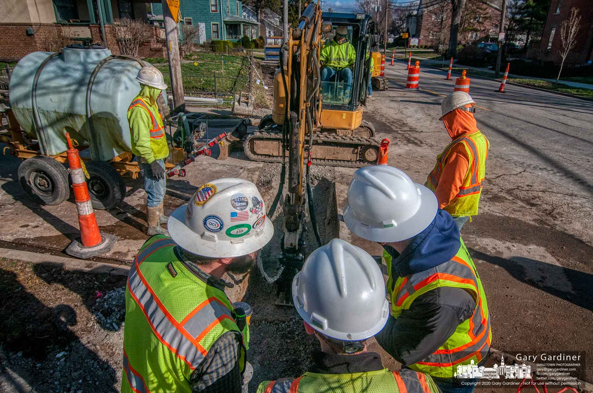 A trio of inspectors prepares to measure the compaction of materials placed over new waterlines laid on North State Street as part of the Uptown Improvement project. My Final Photo for March 13, 2020.
