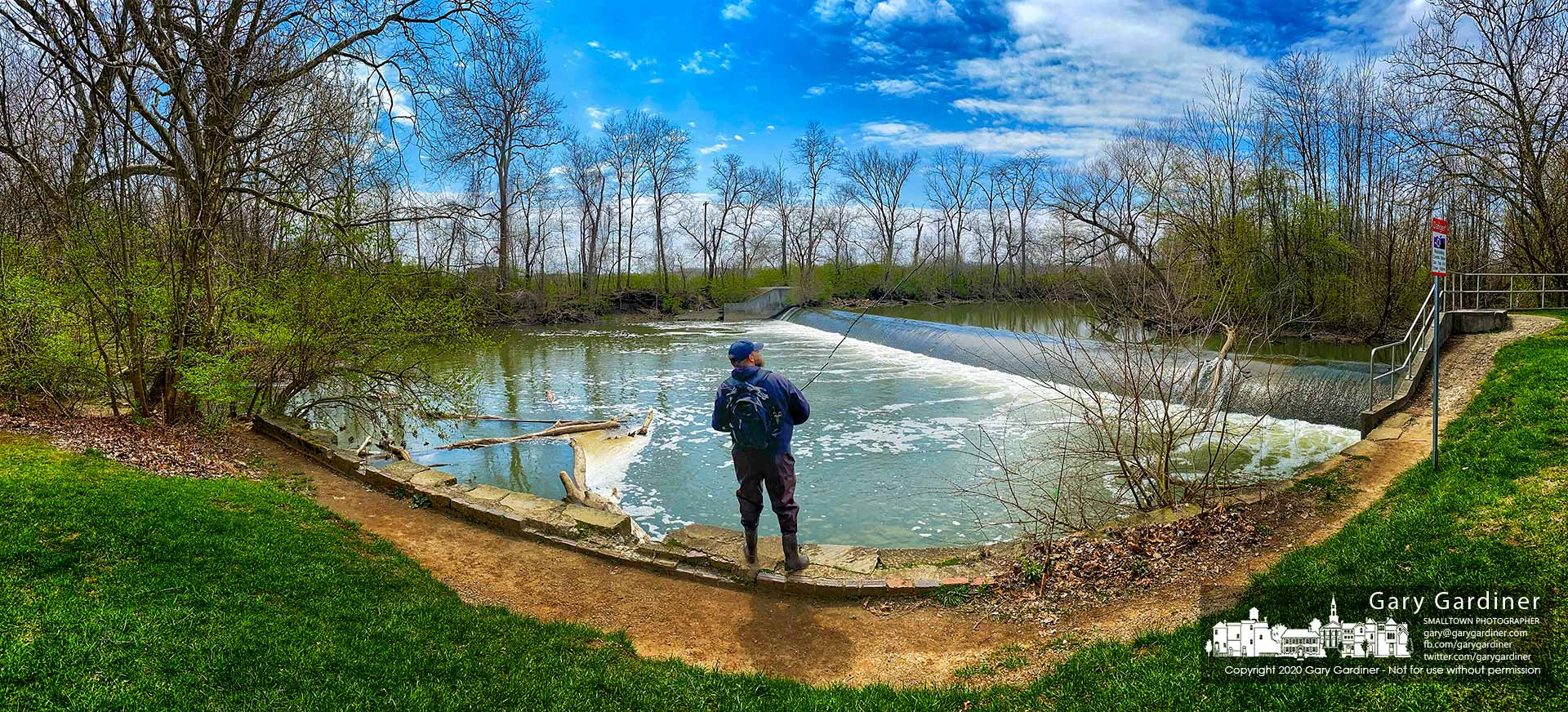 A lone fisherman tests the turbulent waters on Alum Creek just below the low-head dam on West Main Street. My Final Photo for April 11, 2020.