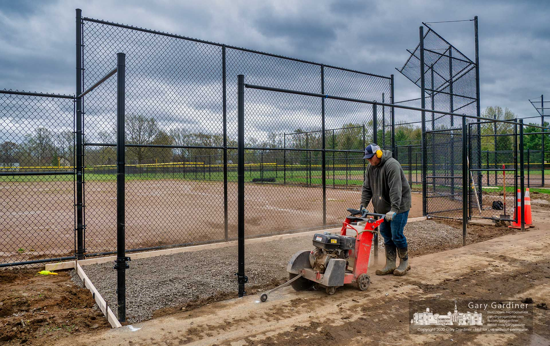Workers continue to upgrade the baseball fields at Highlands with new fencing and changes to the dugout which will have concrete pads once the season is allowed to begin. My Final Photo for April 30, 2020.