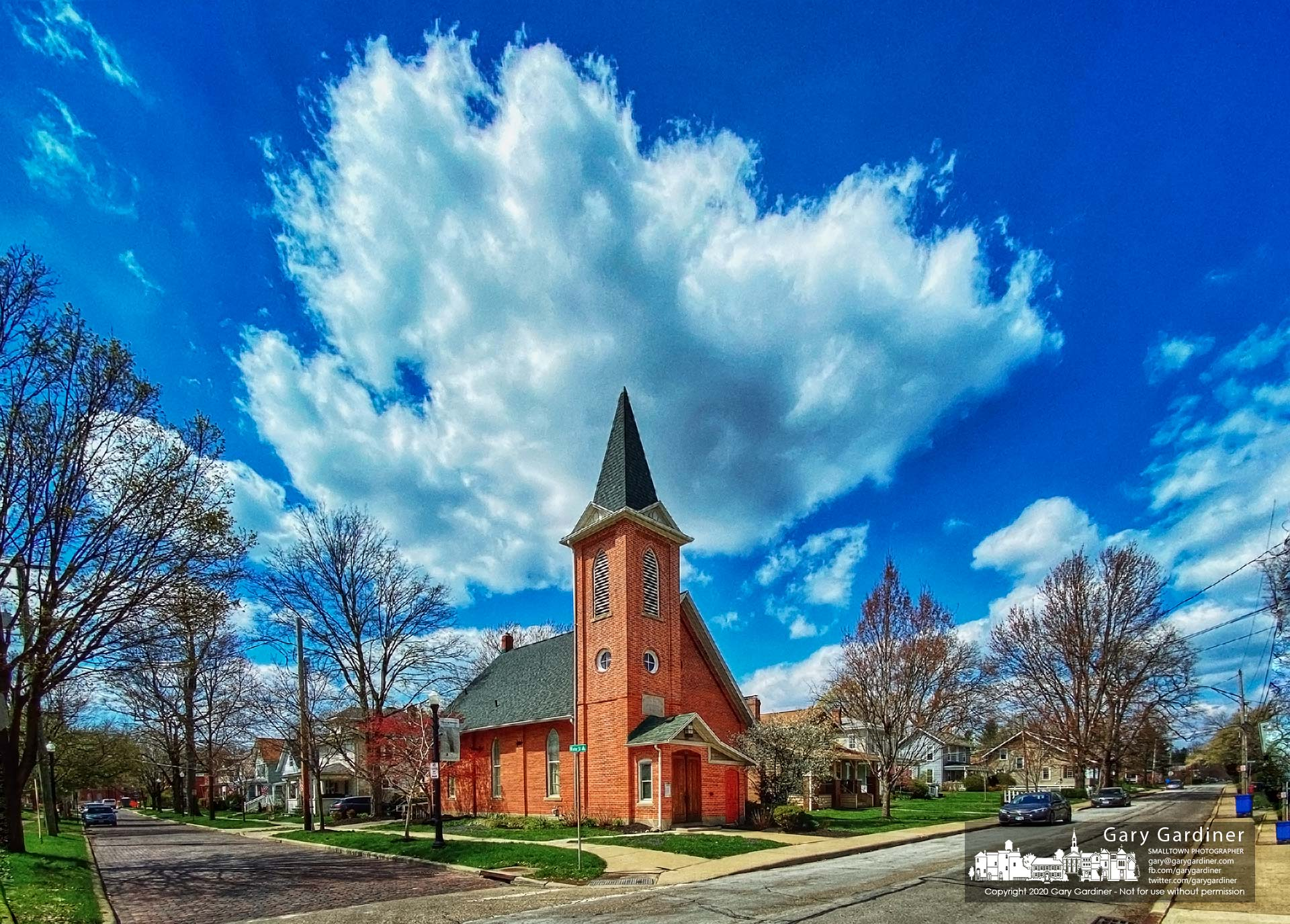 Spring clouds float over the Frank Museum in Uptown Westerville after morning temperatures dropped below freezing. My Final Photo for April 16, 2020.