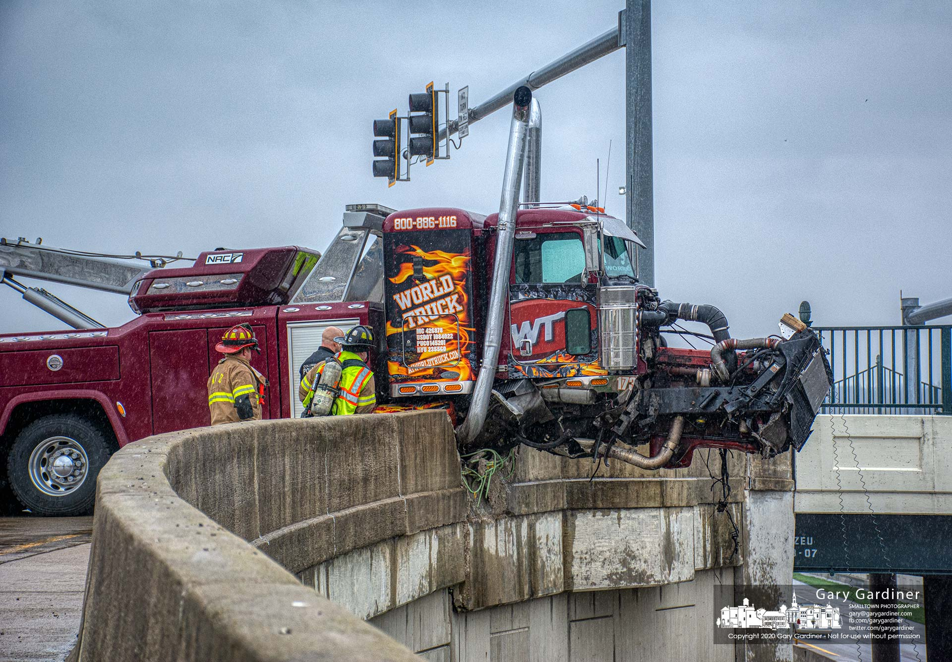 Westerville firefighters and Blendon Township police inspect the damage to a wrecker and retaining wall after the truck crashed at the Sunbury Road westbound intersection to 161 and I270. My Final Photo for April 17, 2020.