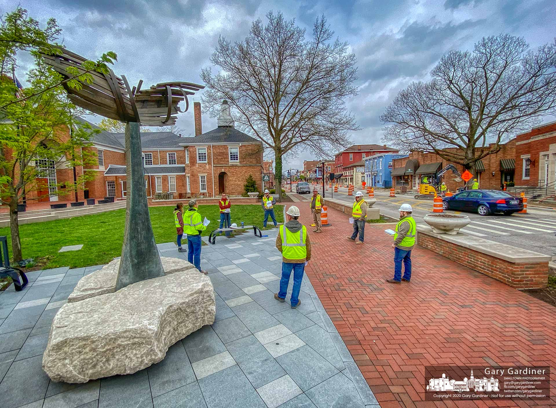 Contractors and inspectors for the Uptown project gather for an afternoon meeting standing six feet apart in front of City Hall before moving to the rear of the building to be better heard over street and construction noise. My Final Photo for April 14, 2020.