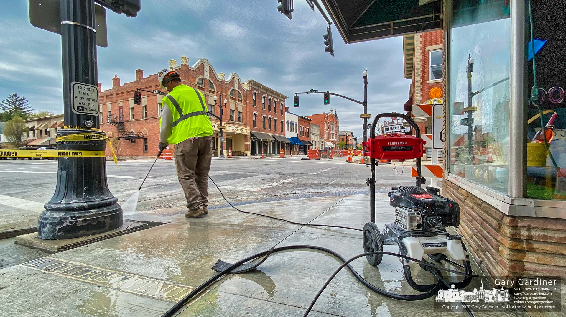 Sections of new sidewalk in Uptown Westerville are cleaned with a pressure washer as the accelerated construction schedule means earlier completion of portions of the Uptown Improvement Project are completed ahead of schedule. My Final Photo for April 22, 2020.