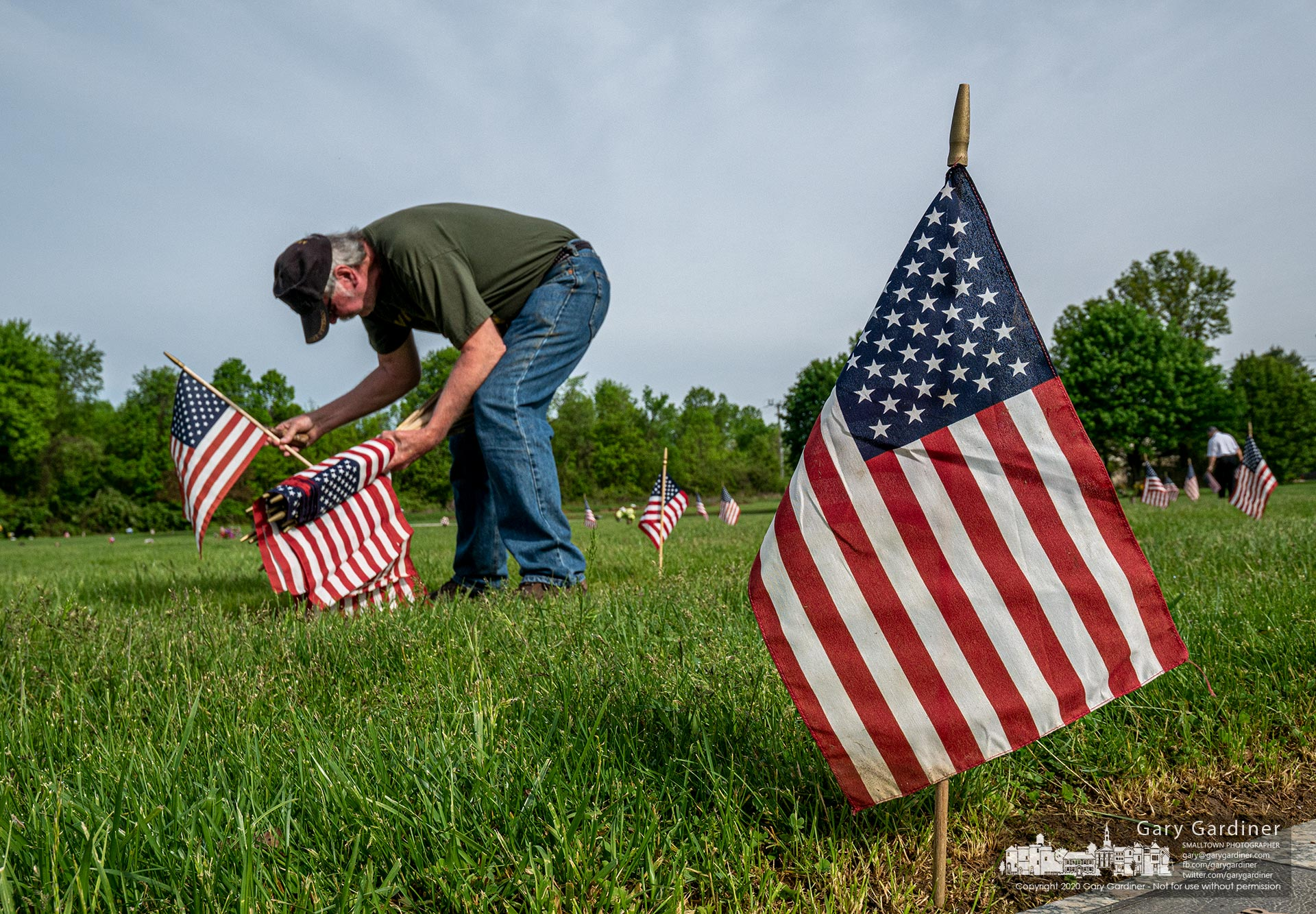 In an annual ritual a Westerville American Legion member places a flag at the gravestone of a veteran buried at Northlawn Cemetery. My Final Photo for May 23, 2020.