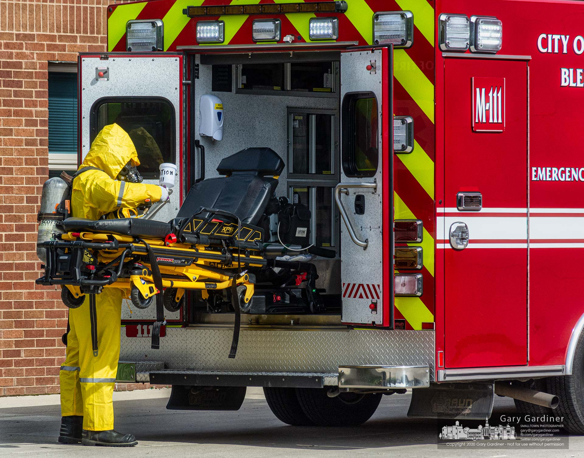 A Westerville firefighter decontaminates the Medic 111 truck after it transported a patient to the hospital. My Final Photo for May 4, 2020.