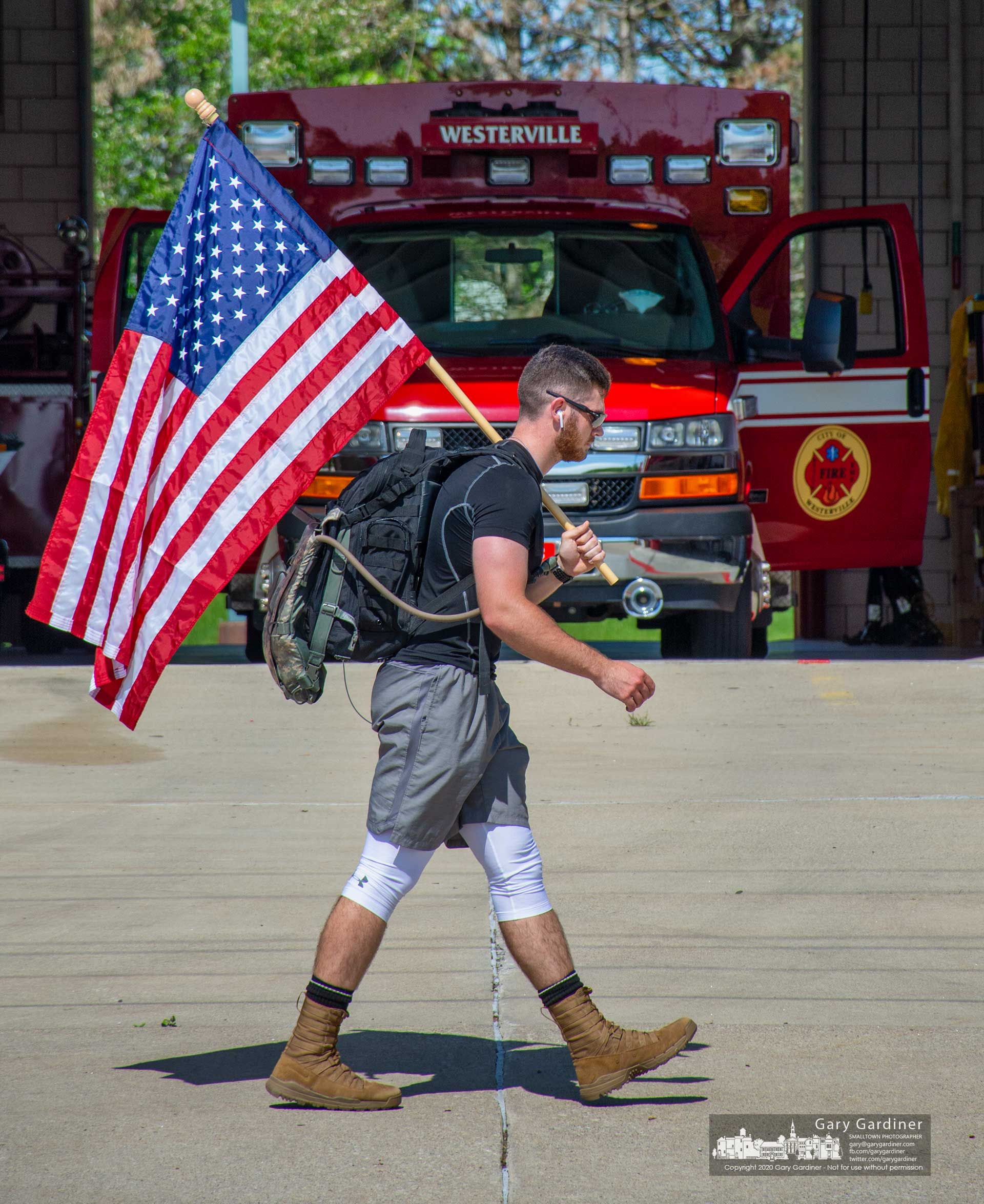 Ohio State junior and Army ROTC cadet Max Congrove passes Westerville Fire Station 113 about three-quarters of his way through an 11-mile hike wearing a 50-pound pack to honor American war dead on Memorial Day. My Final Photo for May 25, 2020.