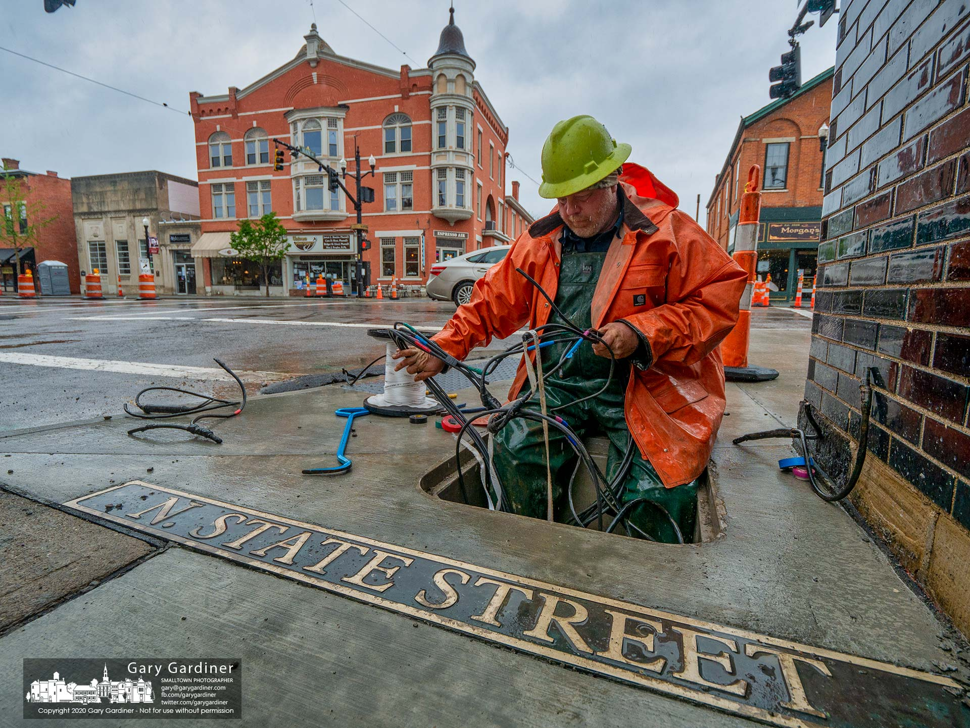 An electrician sorts through old and new cabling for streetlights and signal lights as he replaces old underground cables as part of the Uptown Improvement Project. My Final Photo for May 21, 2020.