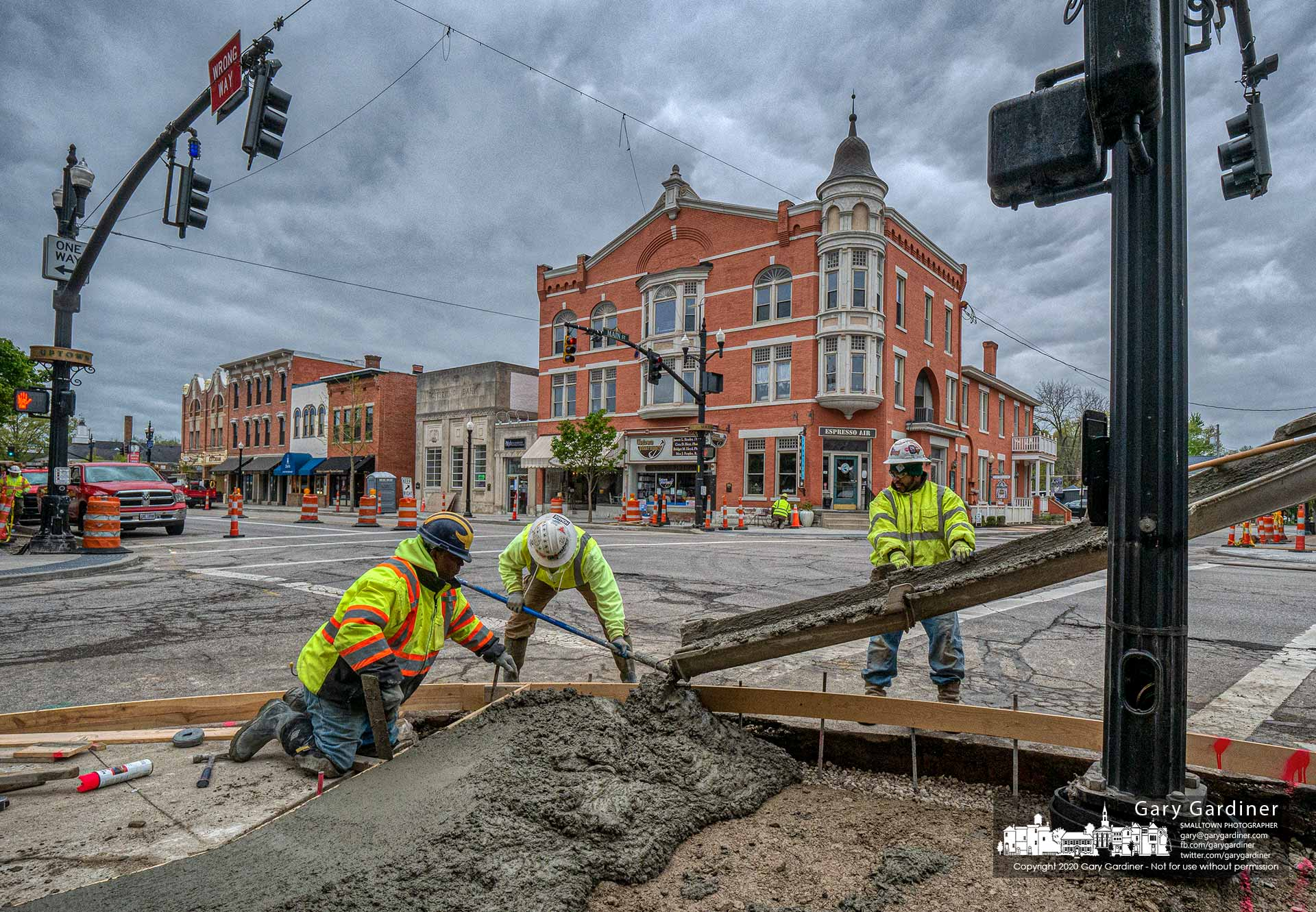 A construction crew pours concrete at the corner of East Main and State Streets completing a large portion of the new sidewalks in Uptown just in time for the reopening of some businesses closed during the pandemic. My Final Photo for May 11, 2020.