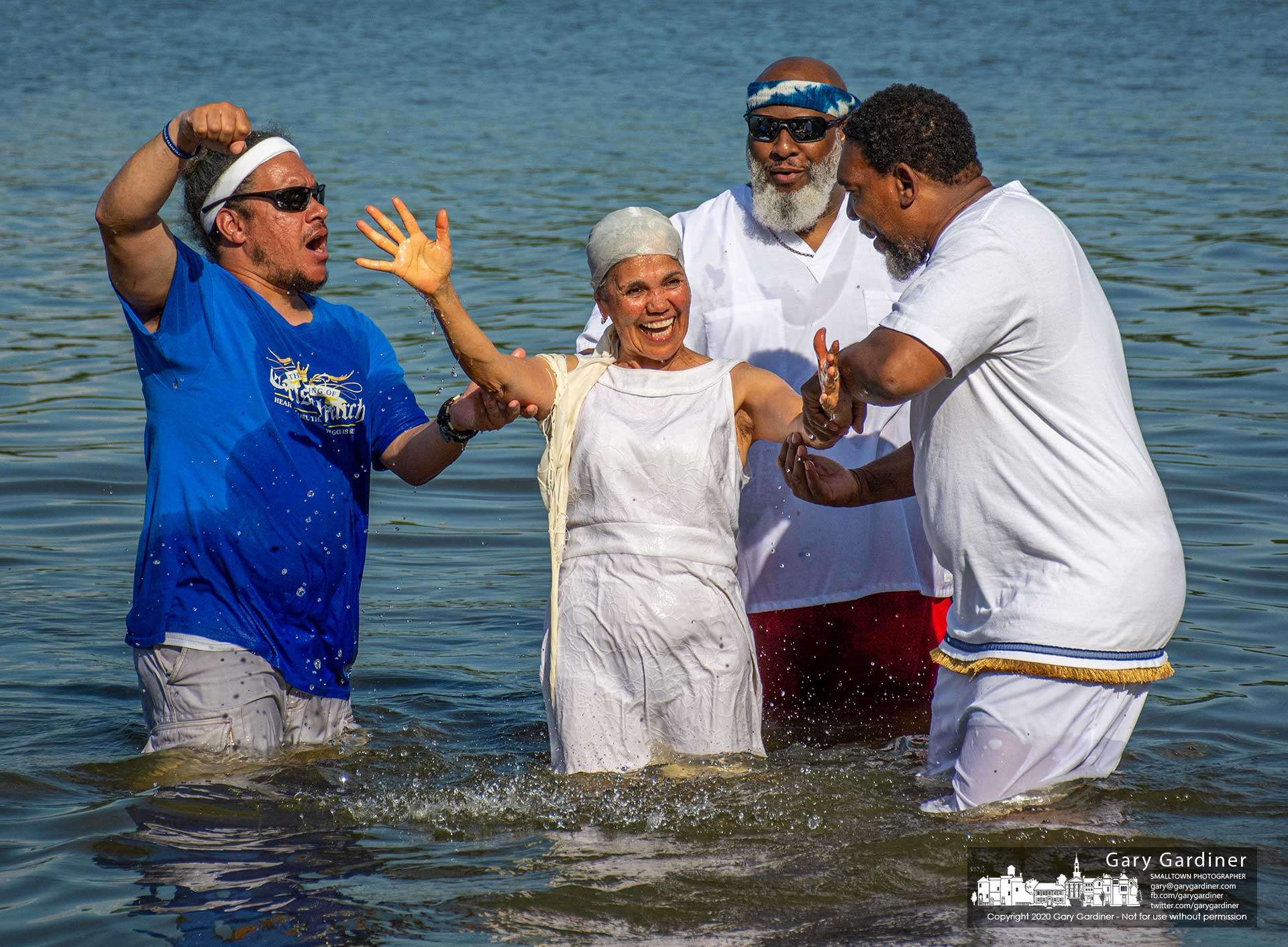 A woman celebrates after her baptism in Hoover Reservoir Saturday by the Gathering of Christ Church in Columbus. My Final Photo for June 6, 2020.