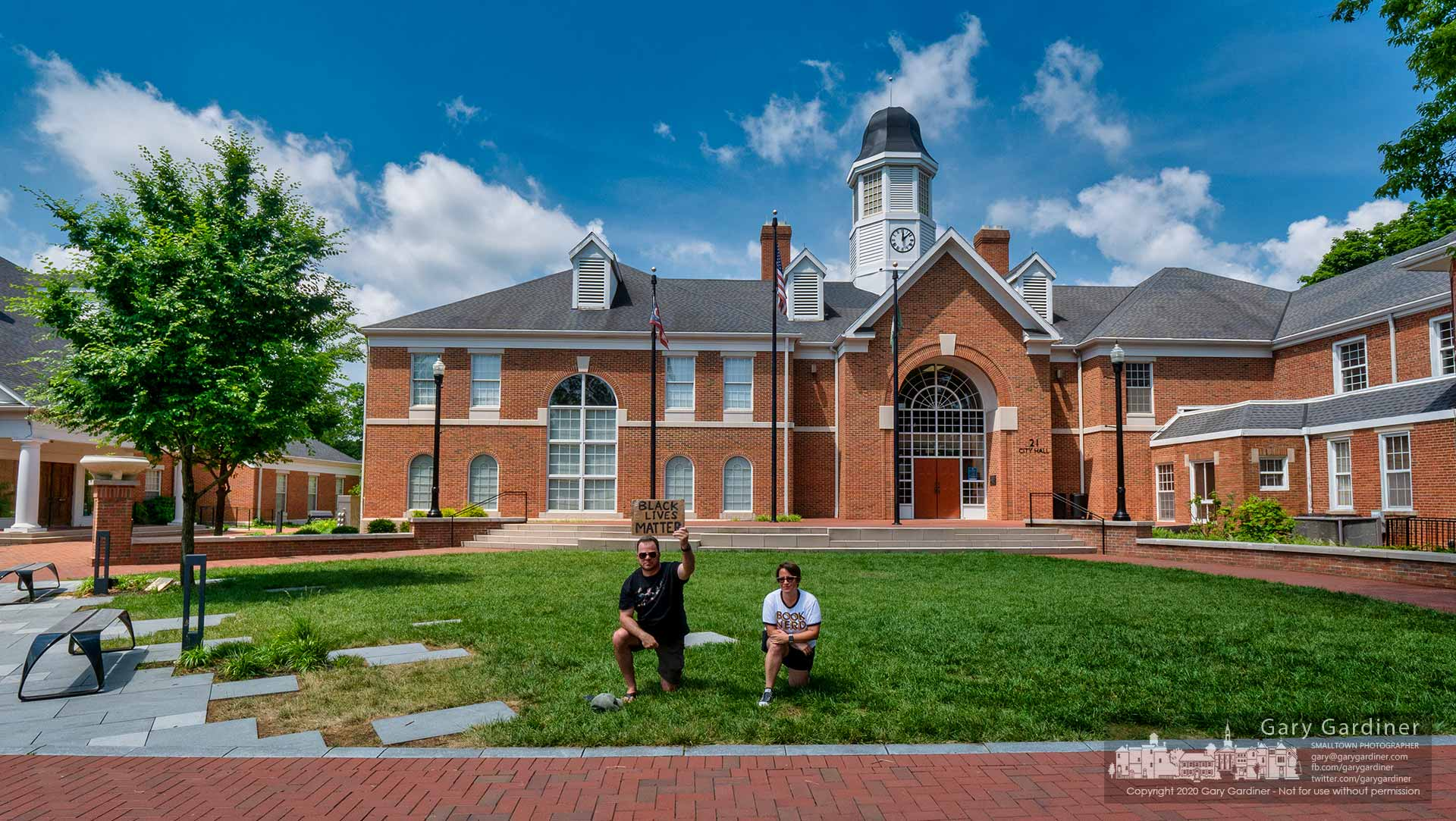 A pair of protesters supporting the BLM movement kneel on the grass in front of Westerville City Hall at noon on Friday. My Final Photo for June 5, 2020.