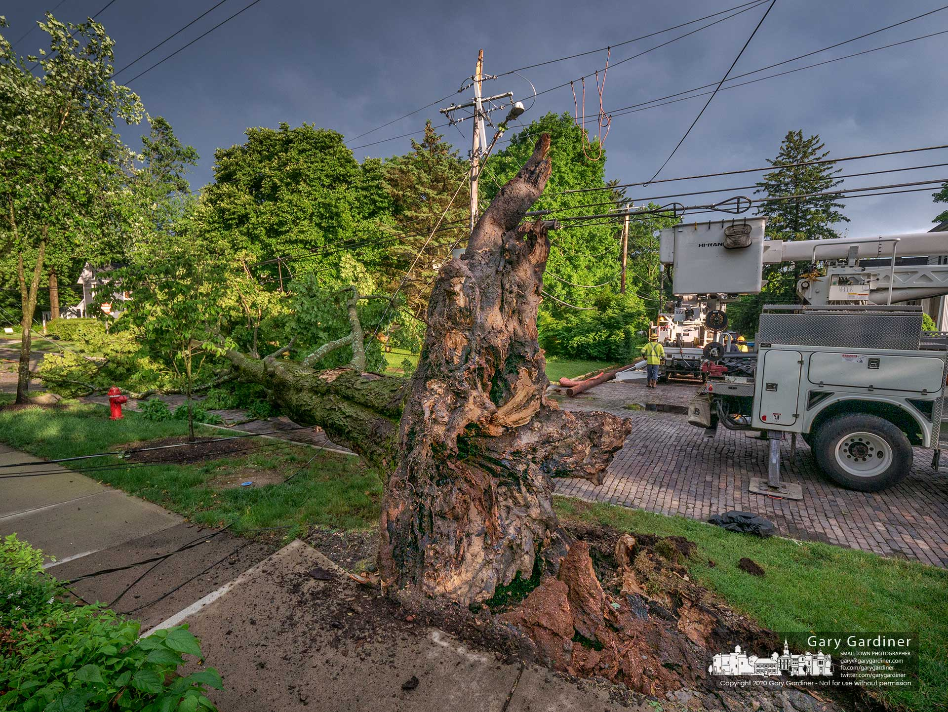 Westerville Electric Department workers begin the process of replacing a utility pole damaged when a tree fell on it during an early evening thunderstorm knocking out power to a neighborhood, Uptown, and portions of State Street. My Final Photo for June 10, 2020.
