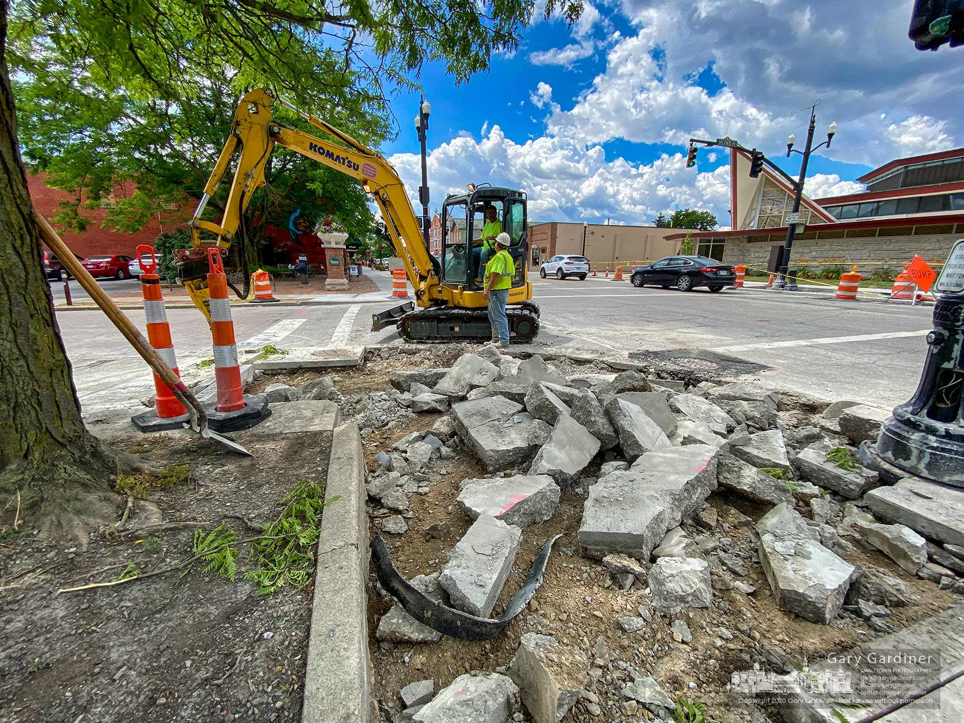 A crew removes a section of recently poured sidewalk at Home and State after the drew said it failed inspection for the correct slope to meet the new paving surface in the intersection. My Final Photo for June 25, 2020.