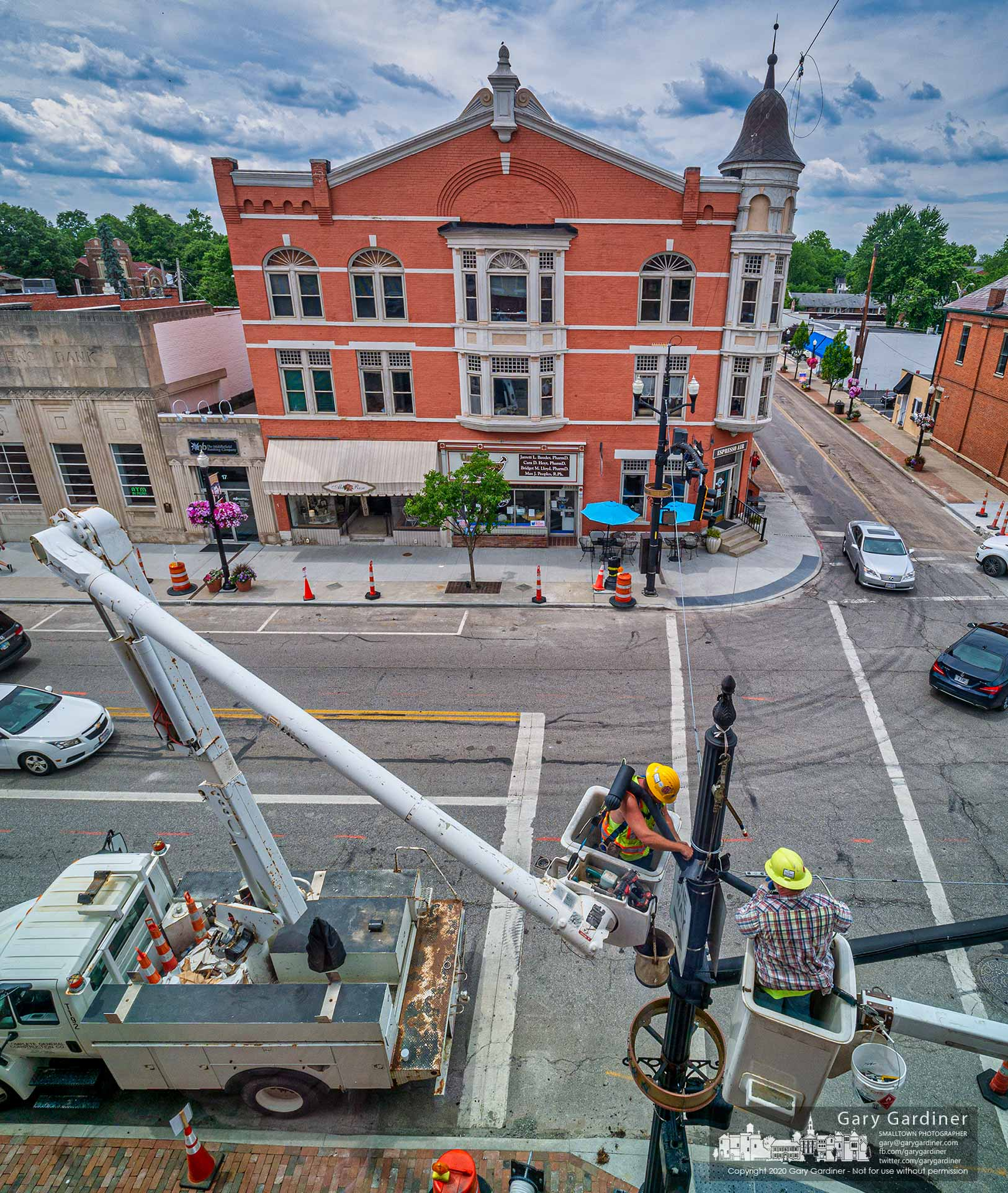 Electricians rewire a light pole at State and Main as part of the Uptown Improvement Project. My Final Photo for June 26, 2020.