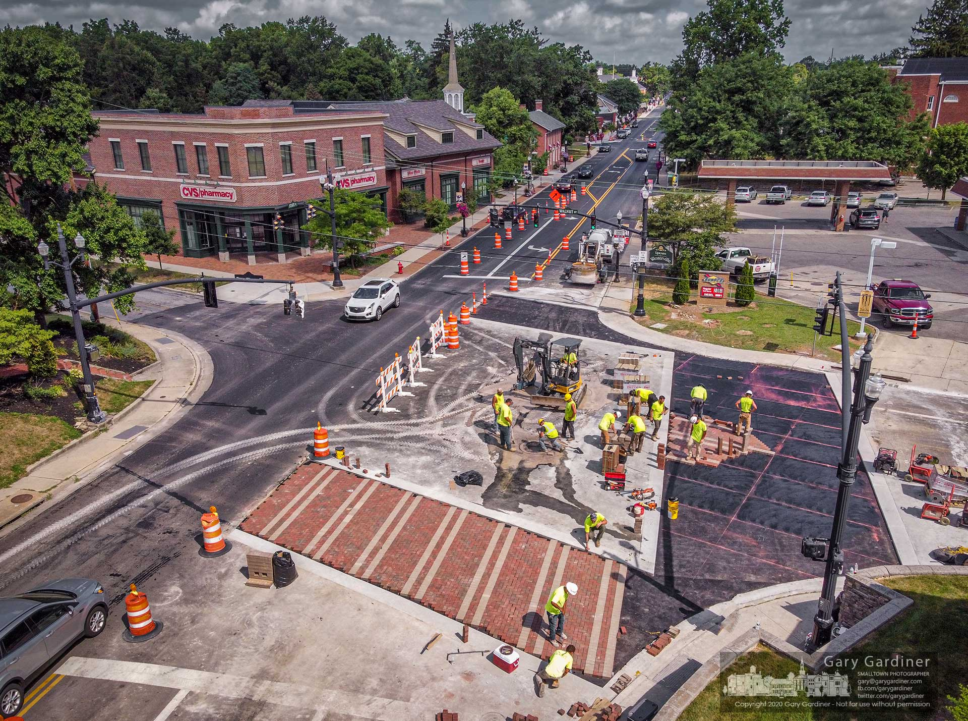 Bricklayers install high-grade pavers on a section of the new crosswalks at State and Walnut Street in Uptown Westerville. My Final Photo for July 27, 2020.