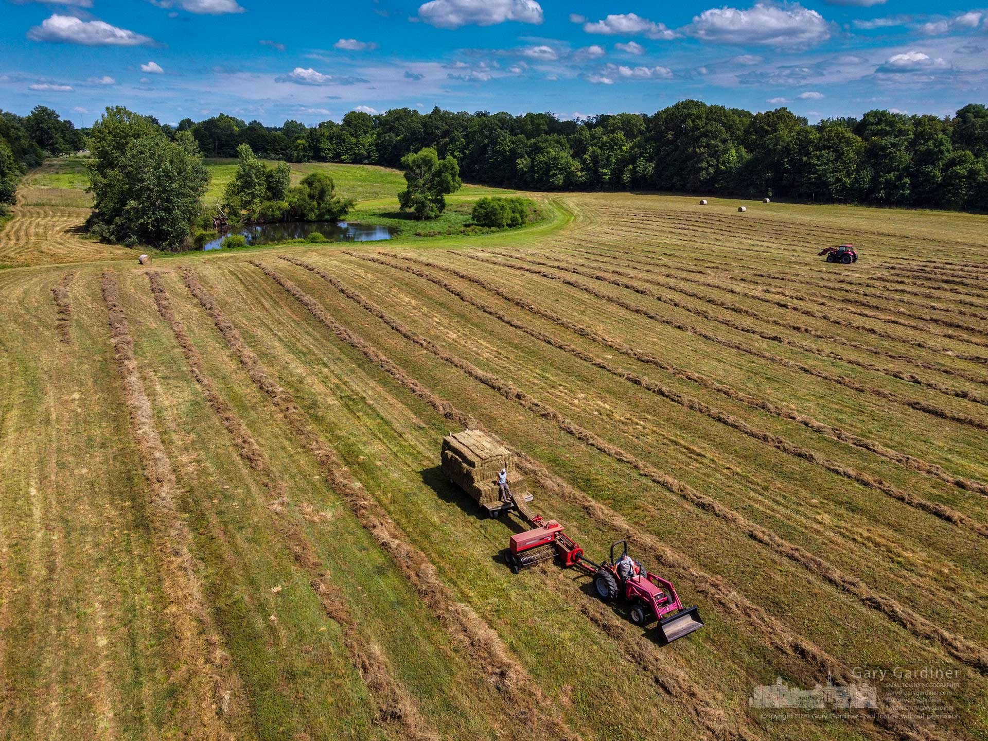 Kevin Scott and his crew bale hay on the farmland around the historic Sharp Family Home on Africa Road. My Final Photo for July 31, 2020.