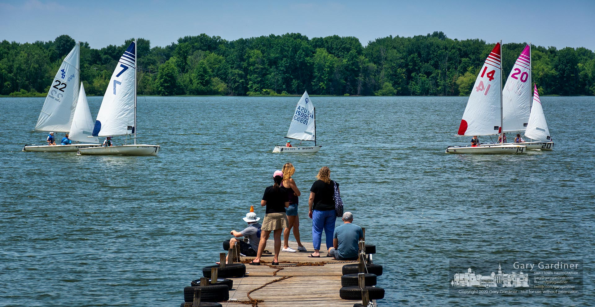 Parents watch from the end of a dock at Hoover Sailing Club as their children approach a turn bouy on Hoover Reservoir during classes Friday afternoon. My Final Photo for July 3, 2020.