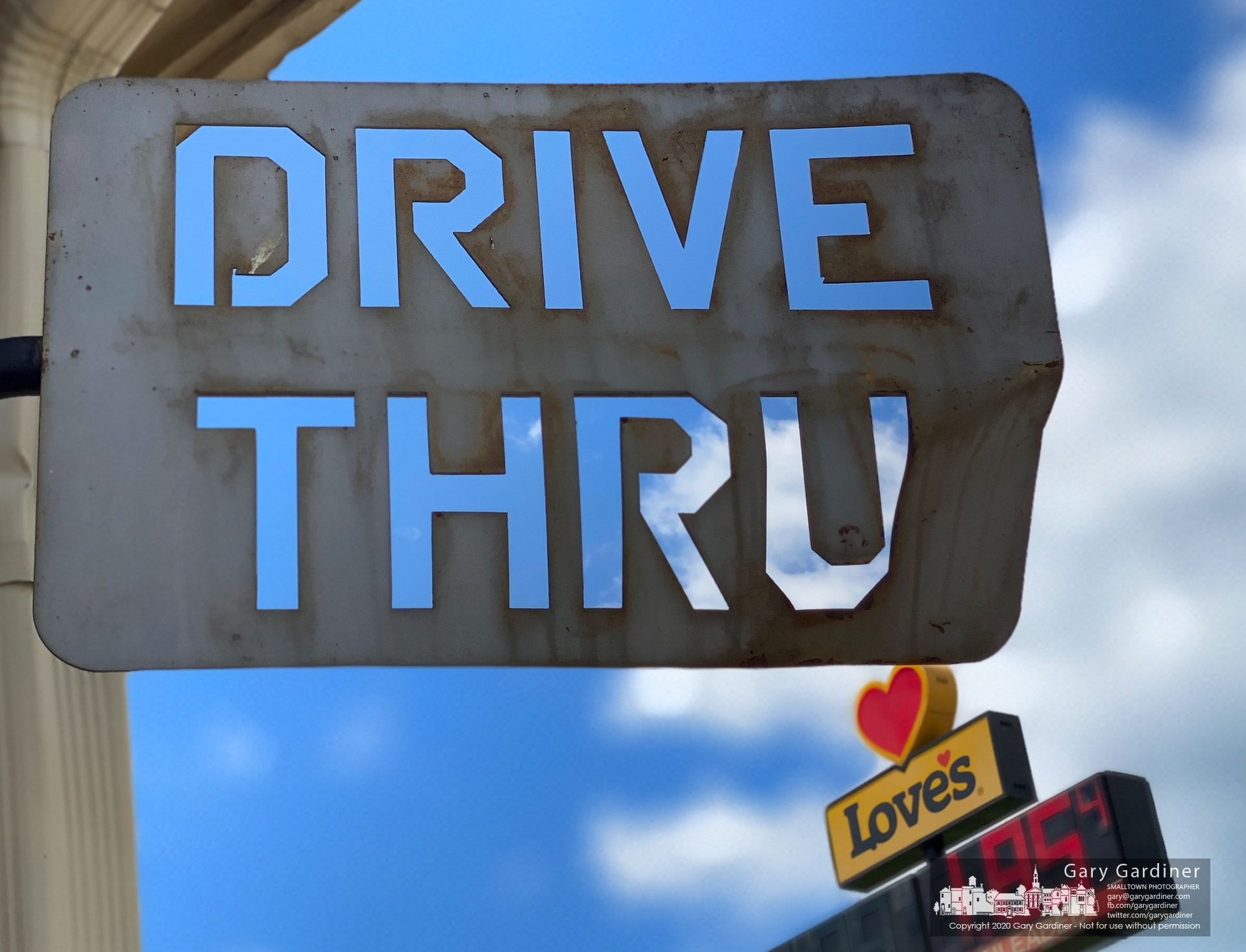 A metal routed letter sign marks a restaurant drive-thru path adjacent to a Love's gas station along the interstate in Kentucky. My Final Photo for July 11, 2020.