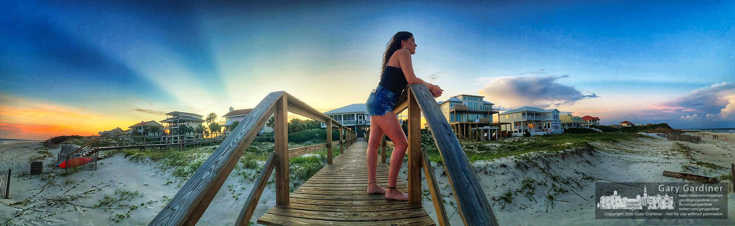 Ashley Robbins watches storm clouds approach the beach at St. George Island, FL, as the sun sets behind the island. My Final Photo for July 17, 2020.