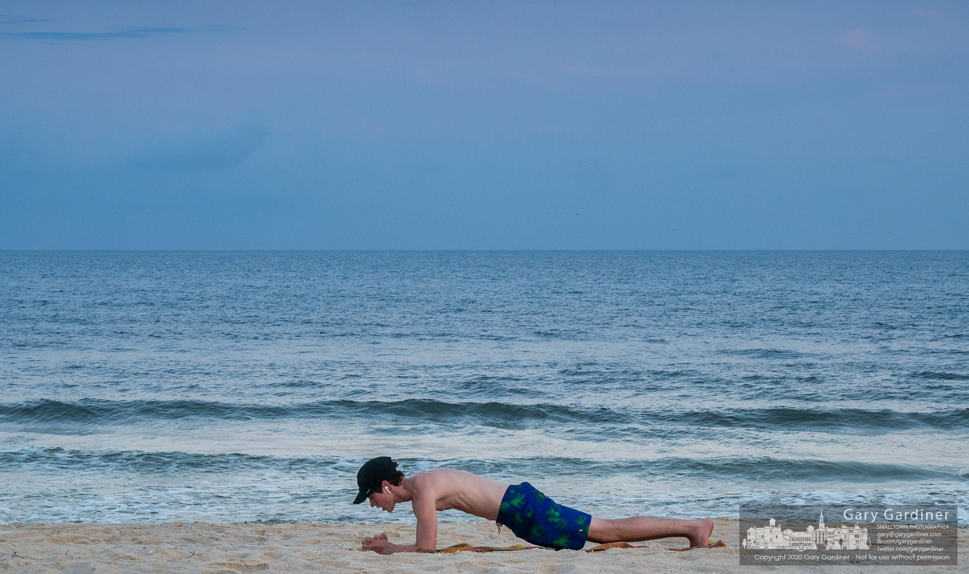 Seventeen-year-old Ryan Robbins performs his evening exercise routine on the beach sands at St. George Island in Florida. My Final Photo for July 13, 2020.