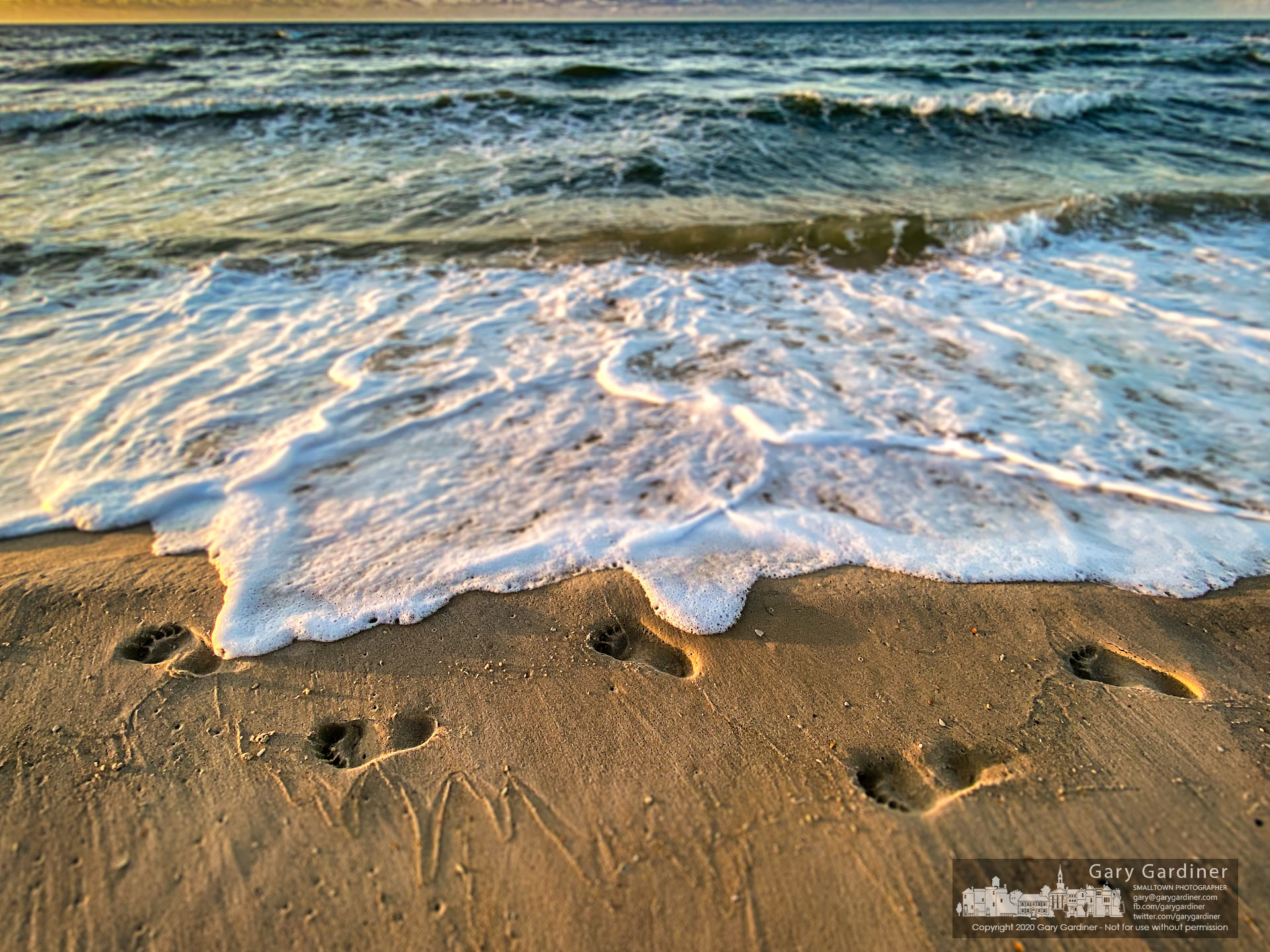 The incoming tide begins to wash away footsteps left in the sand by a vacationer on his last day at St. George Island, FL. My Final Photo for July 18, 2020.