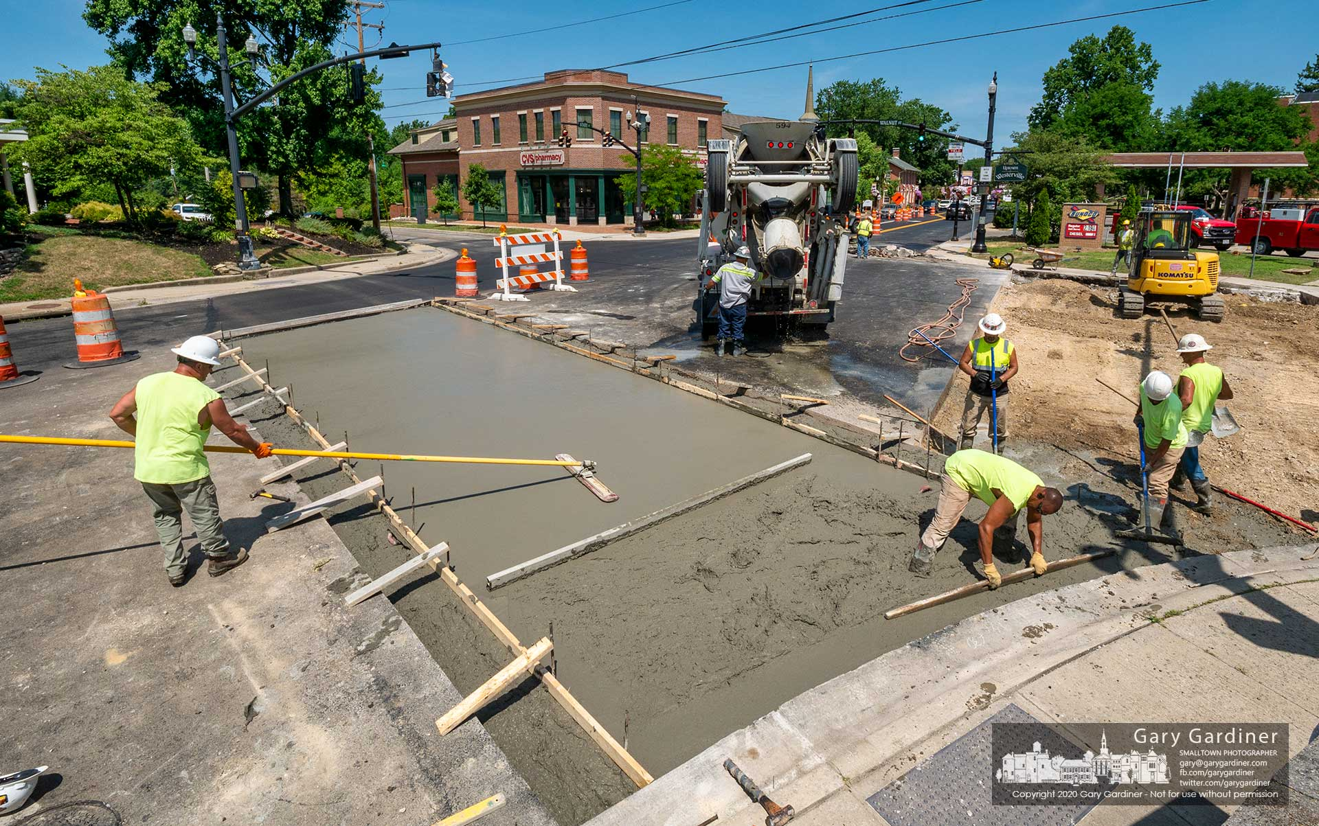 A work crew levels concrete poured into a section of the roadway on State Street at Walnut where a brick crosswalk will be built. My Final Photo for July 21, 2020.