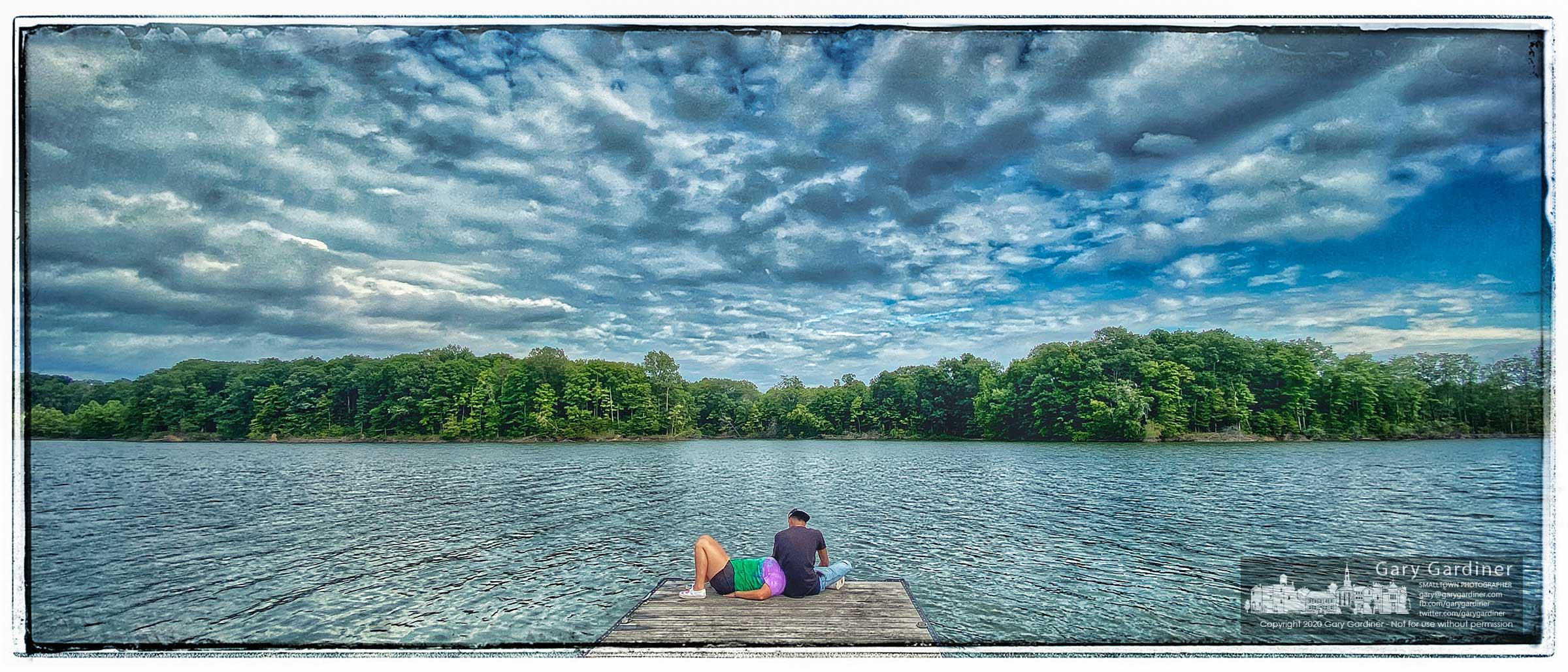A couple takes a moment to enjoy the quiet time before sunset and the return of anglers and their boats returning to the docks at Alum Creek Lake. My Final Photo for Aug. 2, 2020.