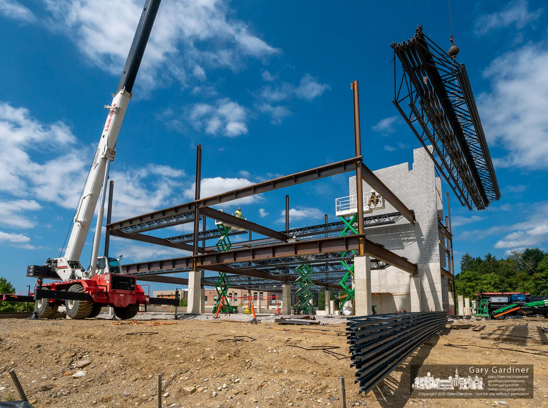 A set of steel struts are lifted to the second floor of the new COPC office building under construction behind the company's two other buildings on Africa Road. My Final Photo for Aug. 31, 2020.