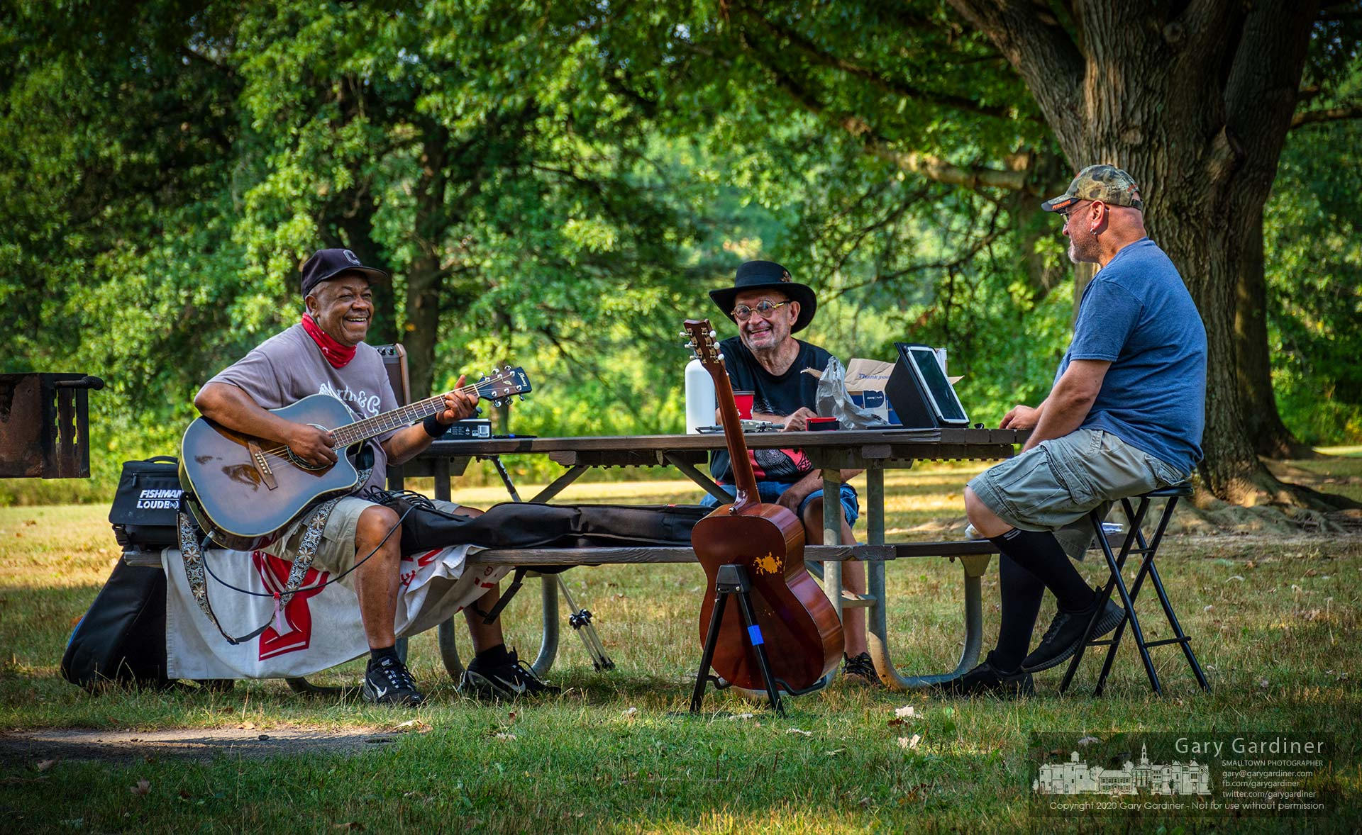 A trio of musicians gather at Sharon Woods Wednesday morning to share songs, stories, and friendship in the shade of oak trees before the day becomes too hot to enjoy. My Final Photo for Aug. 26, 2020.