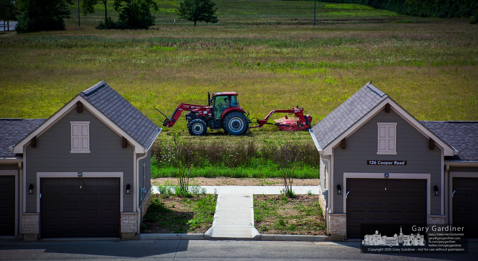 Rodney Parker runs a tractor around the hayfield on Cooper Road adjacent to the new apartment complex under construction next to the bike path along Alum Creek. My Final Photo for Aug. 5, 2020.