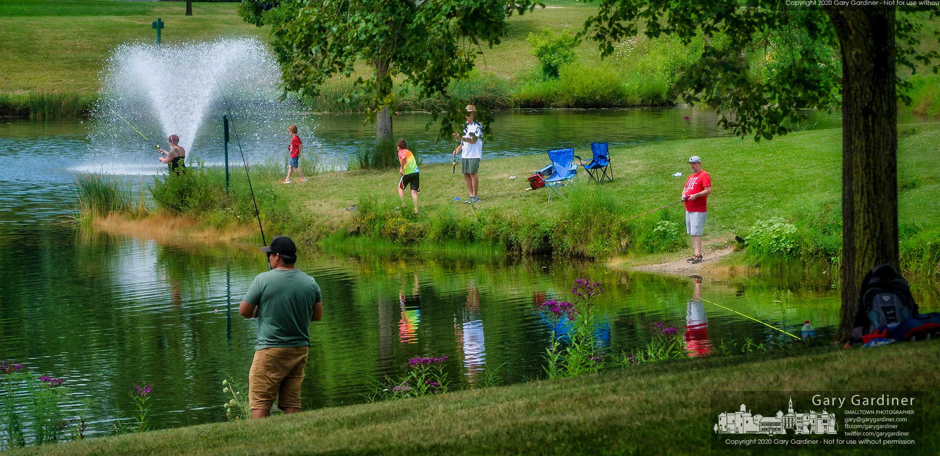 Families fish along the edge of the holding pond at Hoff Woods Park. My Final Photo for Aug. 15, 2020.