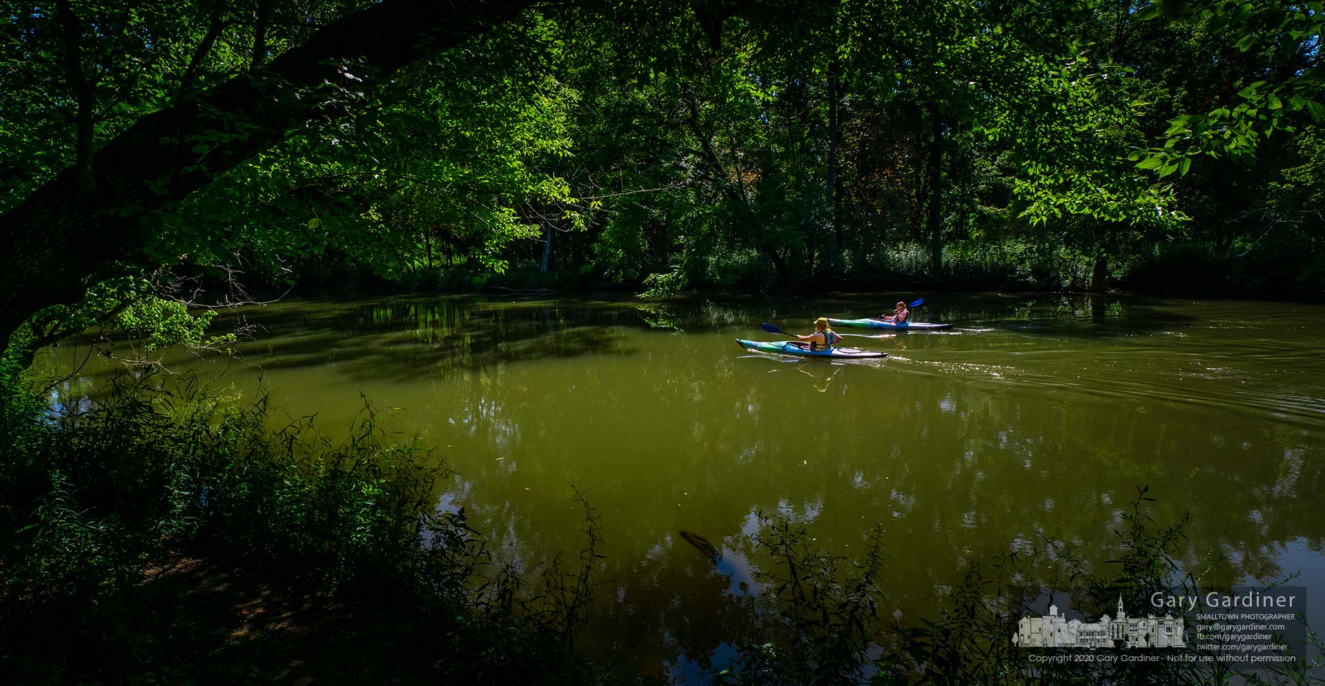 A couple begins their Sunday afternoon kayaking trek on the still waters of Alum Creek from the landing in Kilbourne. My Final Photo for Aug. 9, 2020.