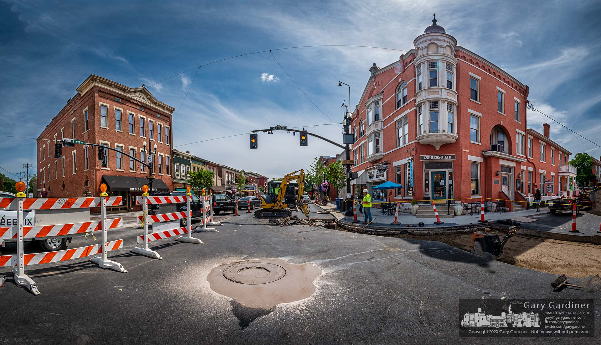 A puddle of asphalt, concrete, and brick mud settles around a donut hole cut around a manhole cover at State and Main in Uptown Westerville where a new, elevated cover surrounded by a block of concrete will replace the old fixture. My Final Photo for Aug. 21, 2020.