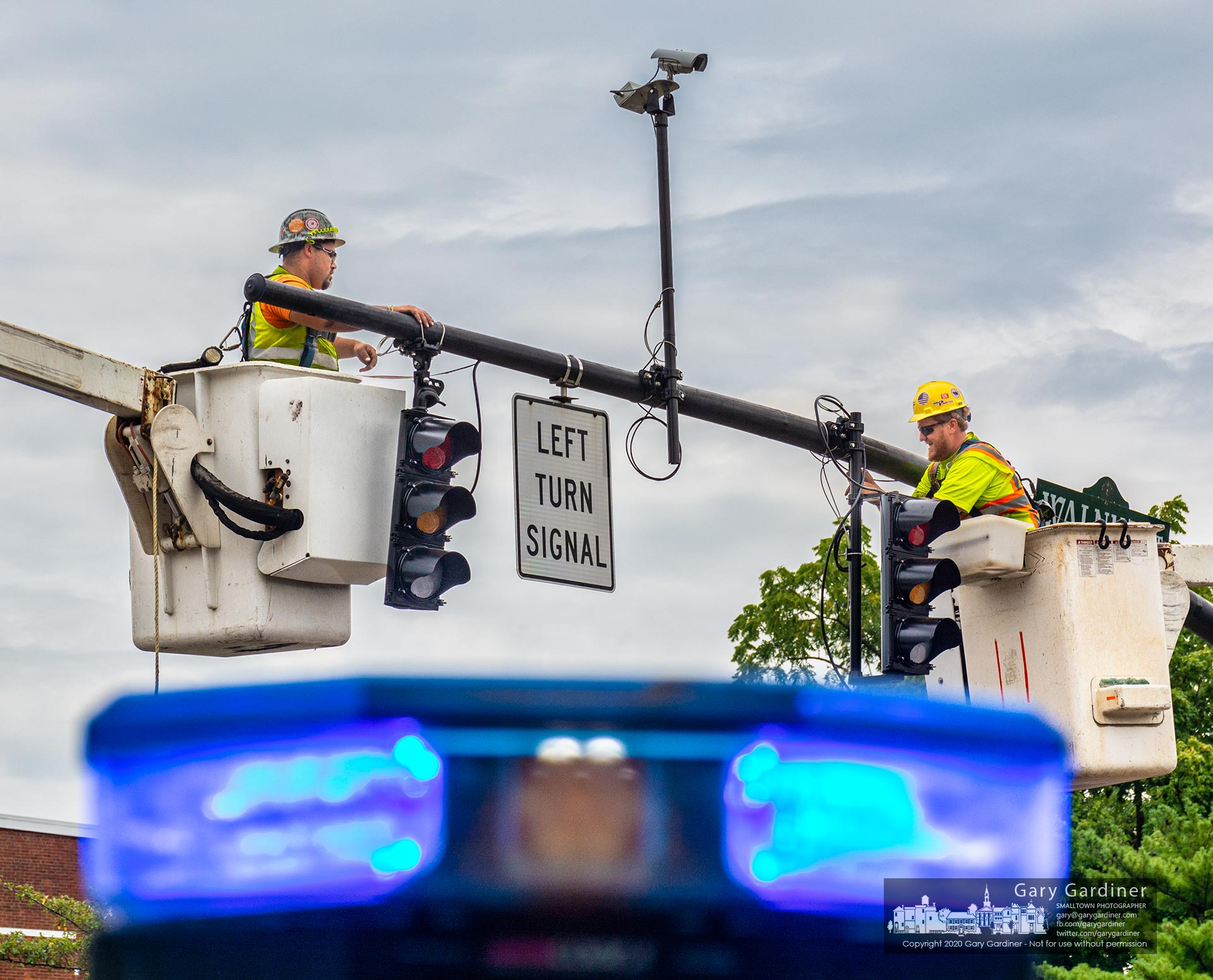 Electricians rewire the traffic signals at State and Main, the last set of signals being rewired as part of the Uptown Improvement Project. My Final Photo for Aug. 18, 2020.
