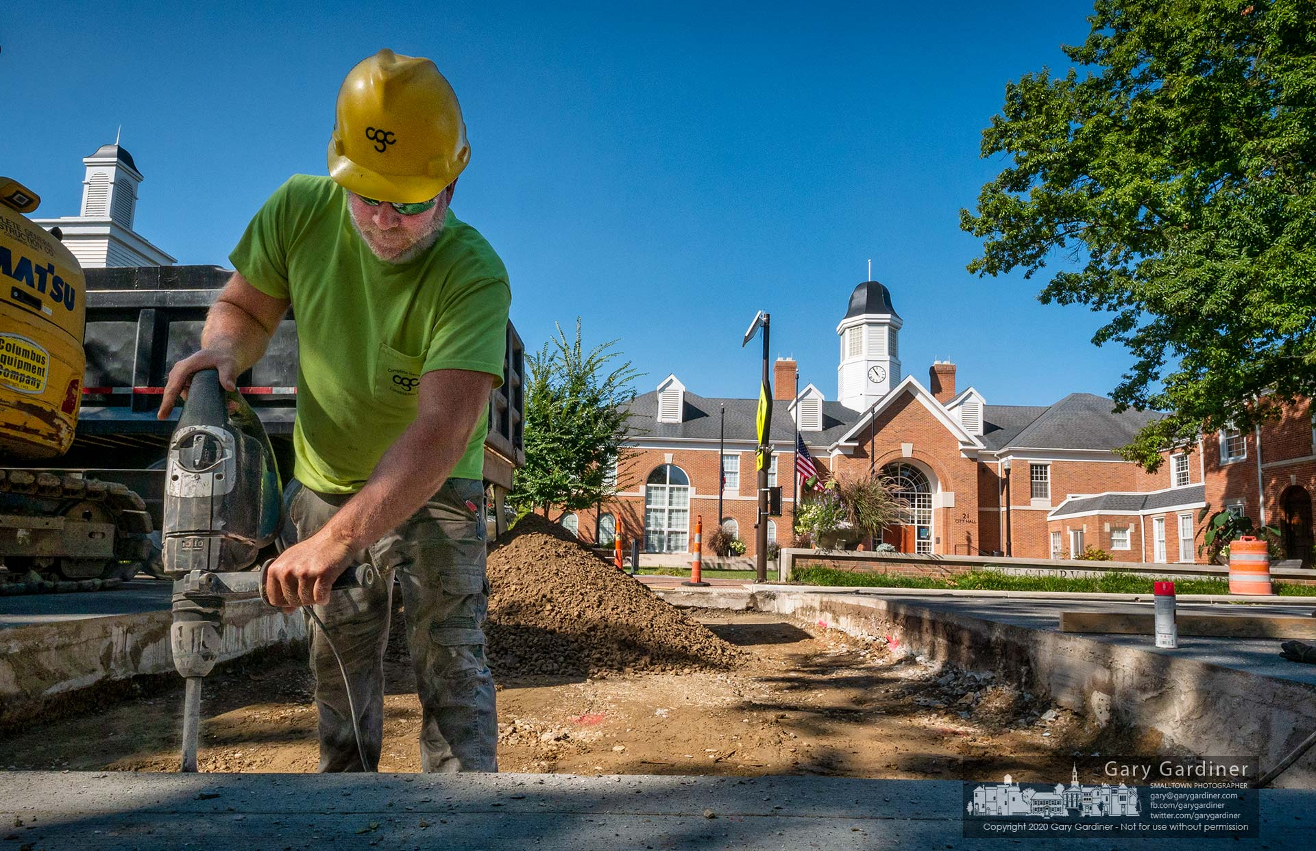 A construction worker hammers away pieces of old concrete to make way for a new layer that will support the brick crosswalk being built across State Street5 in front of city hall. My Final Photo for Sept. 21, 2020.