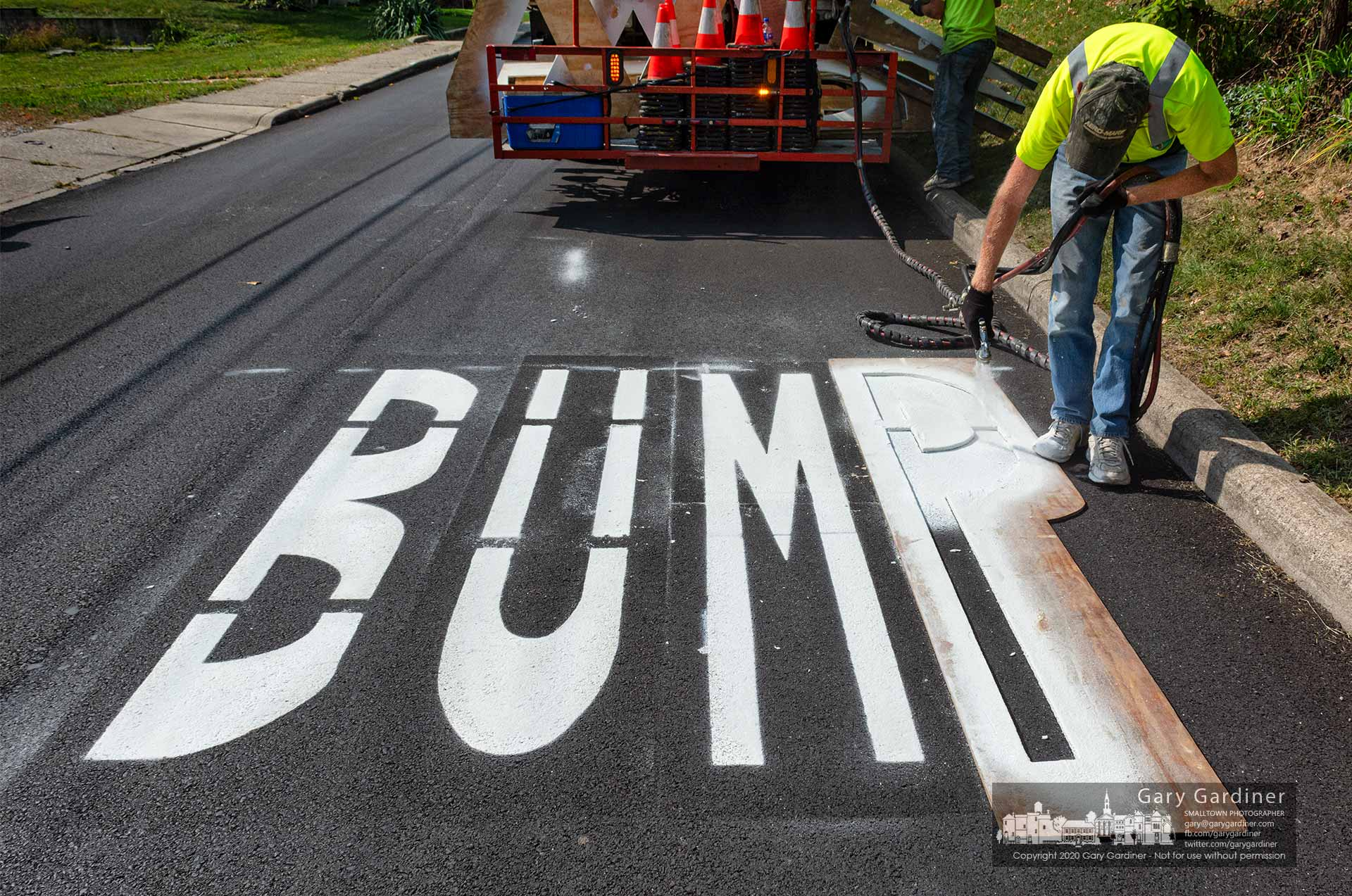 A paint crew works quickly with as little traffic delay as possible to complete the BUMP warning signs at the speed bumps on West Walnut that were rebuilt after the street was recently paved. My Final Photo for Sept. 22, 2020.