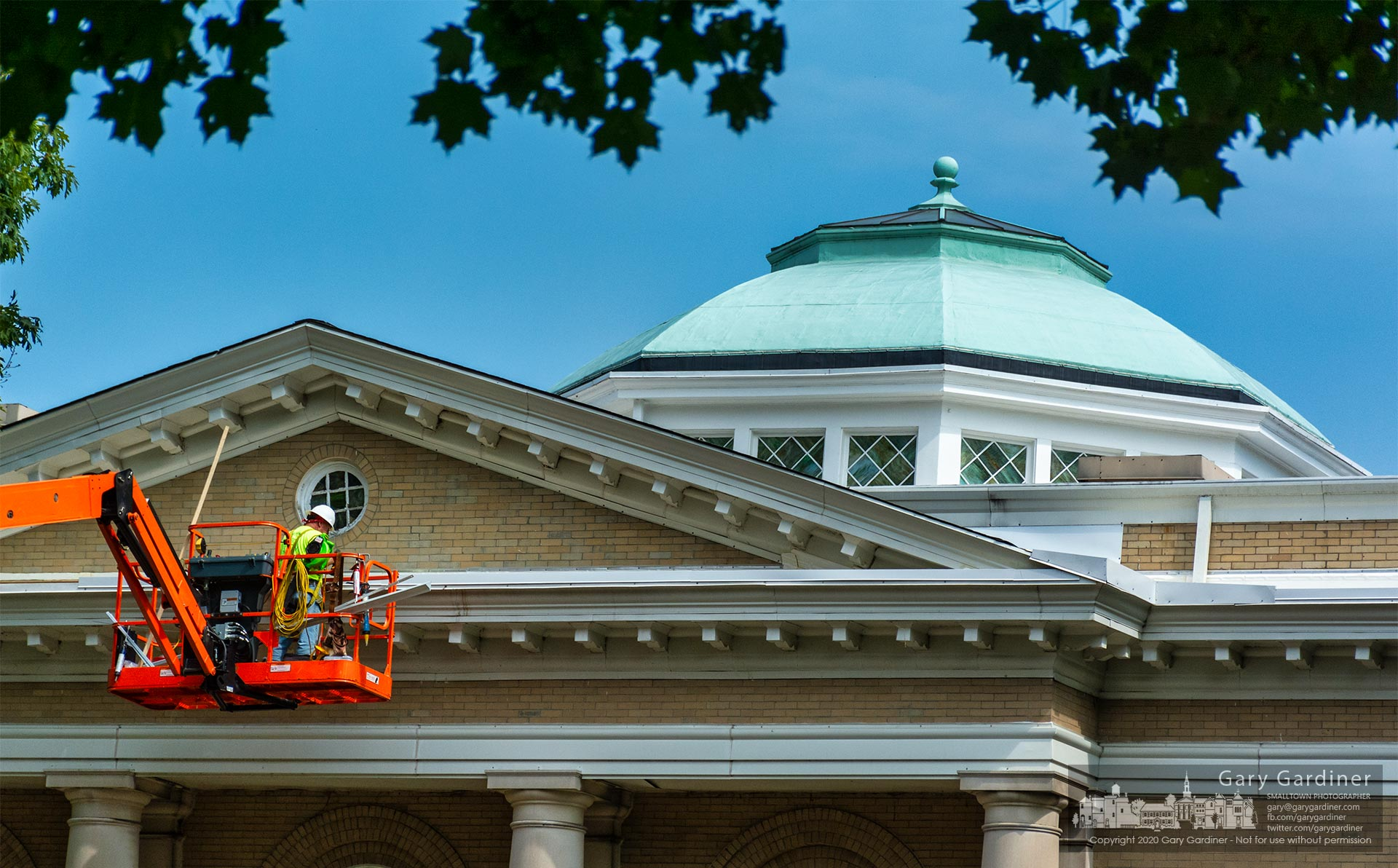 A worker installs new gutters and seals along the roofline of the Church of the Master on Grove Street. My Final Photo for Sept. 24.