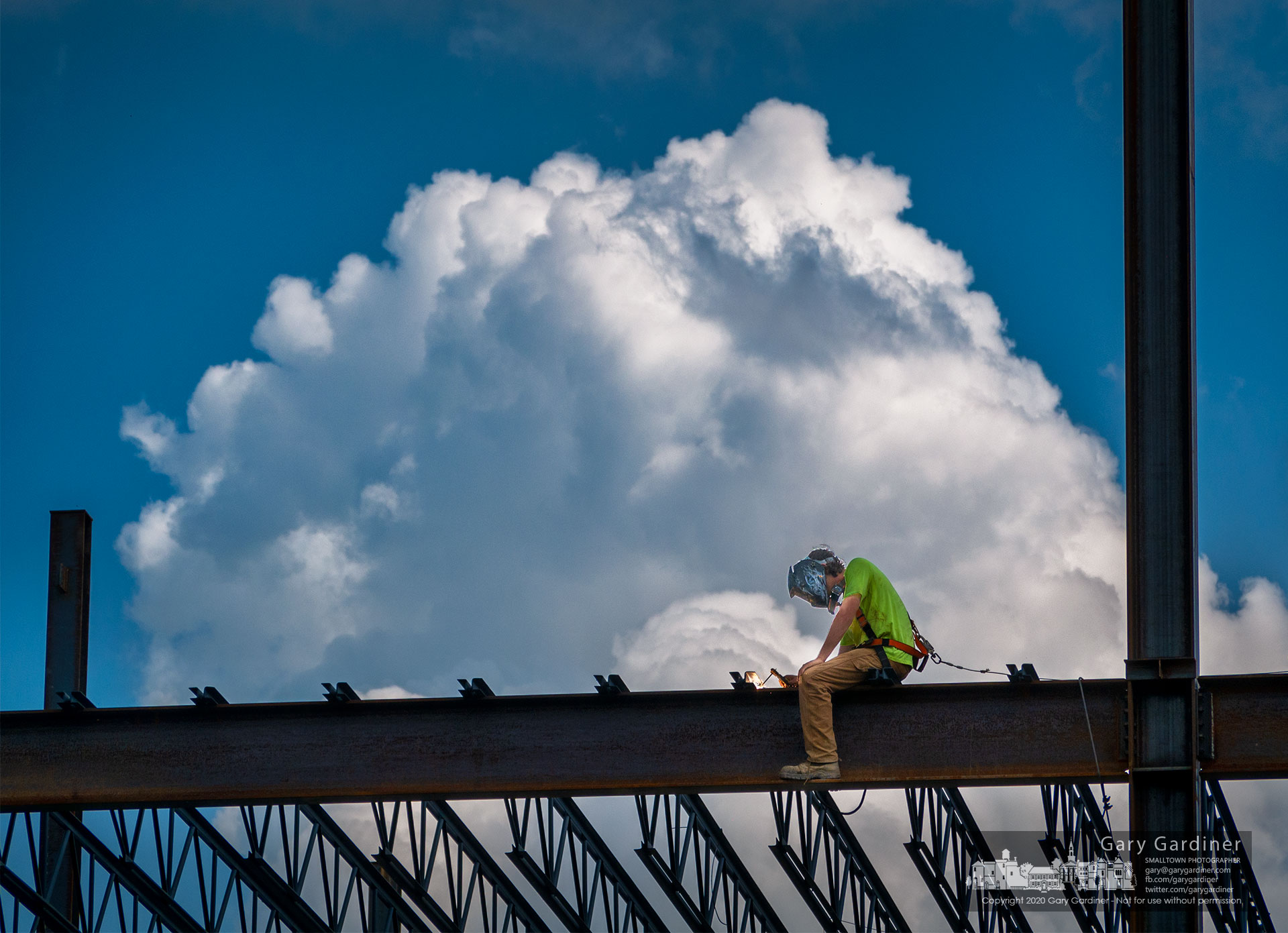 A welder attaches trusses to the steel structure defining the COPC senior treatment facility being built behind the company's other two buildings on Africa Road. My Final Photo for Sept. 8, 2020.