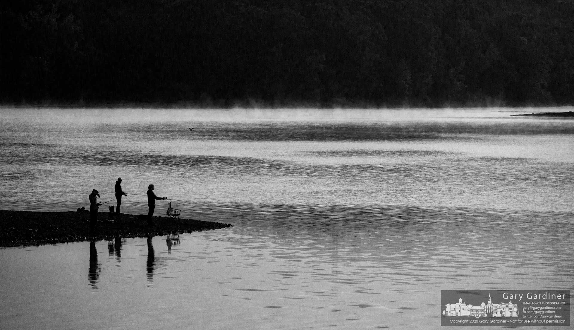 Anglers try their hand casting rods into the water of mist-covered Hoover Reservoir in the morning just after sunrise. My Final Photo for Sept. 17, 2020.