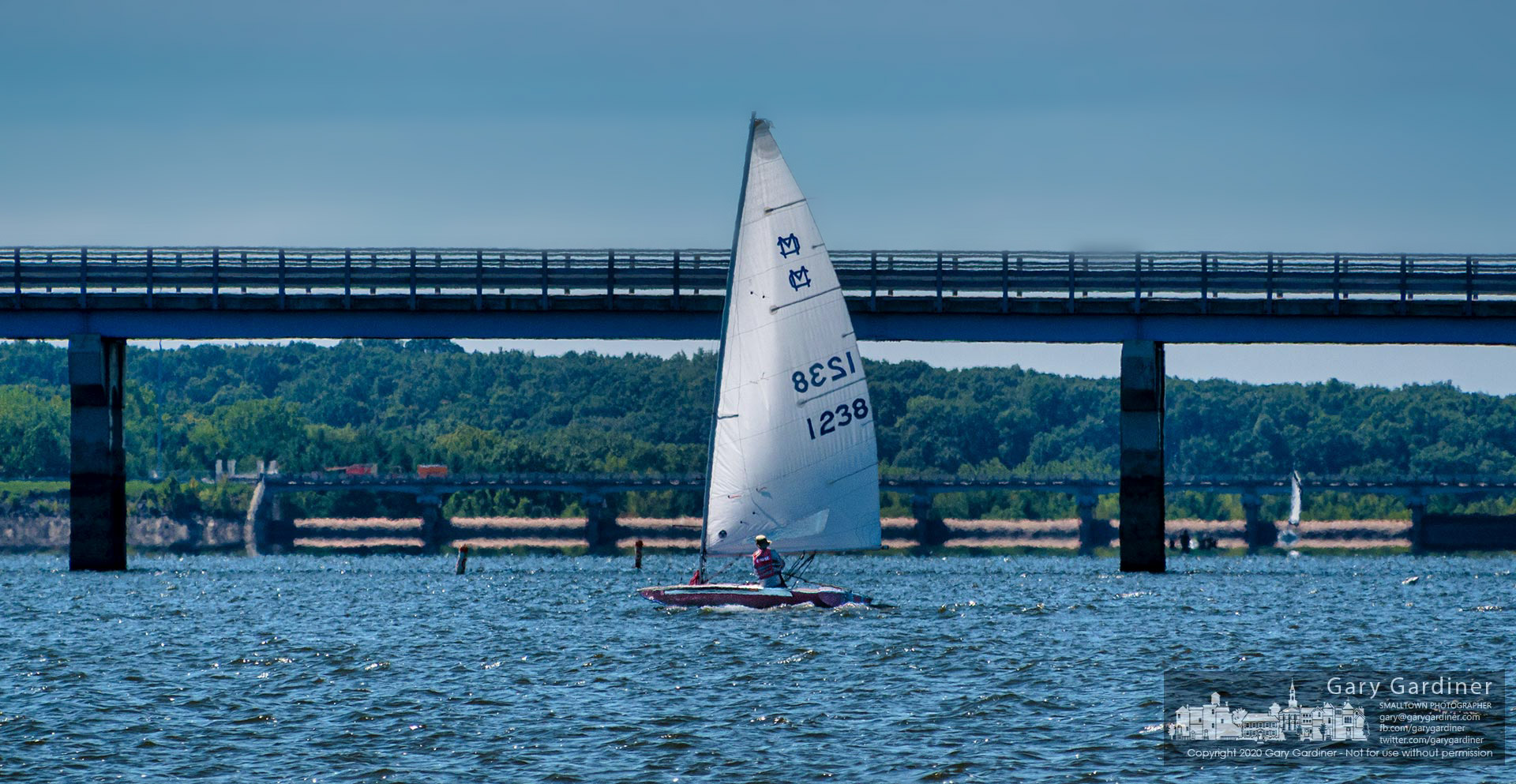 A sailor navigates his way across Hoover Reservoir past the Smothers Road Bridge with Hoover Dam at the horizon on a brisk late summer afternoon. My Final Photo for Sept. 19, 2020.
