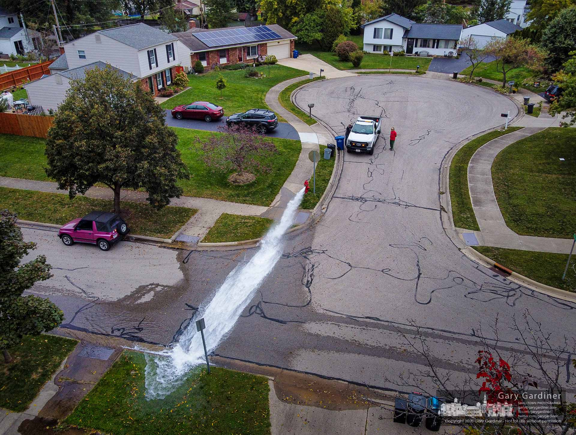 Water from a hydrant opened for testing by city workers flows across Lakeland Dr. My Final Photo for Sept. 29, 2020.