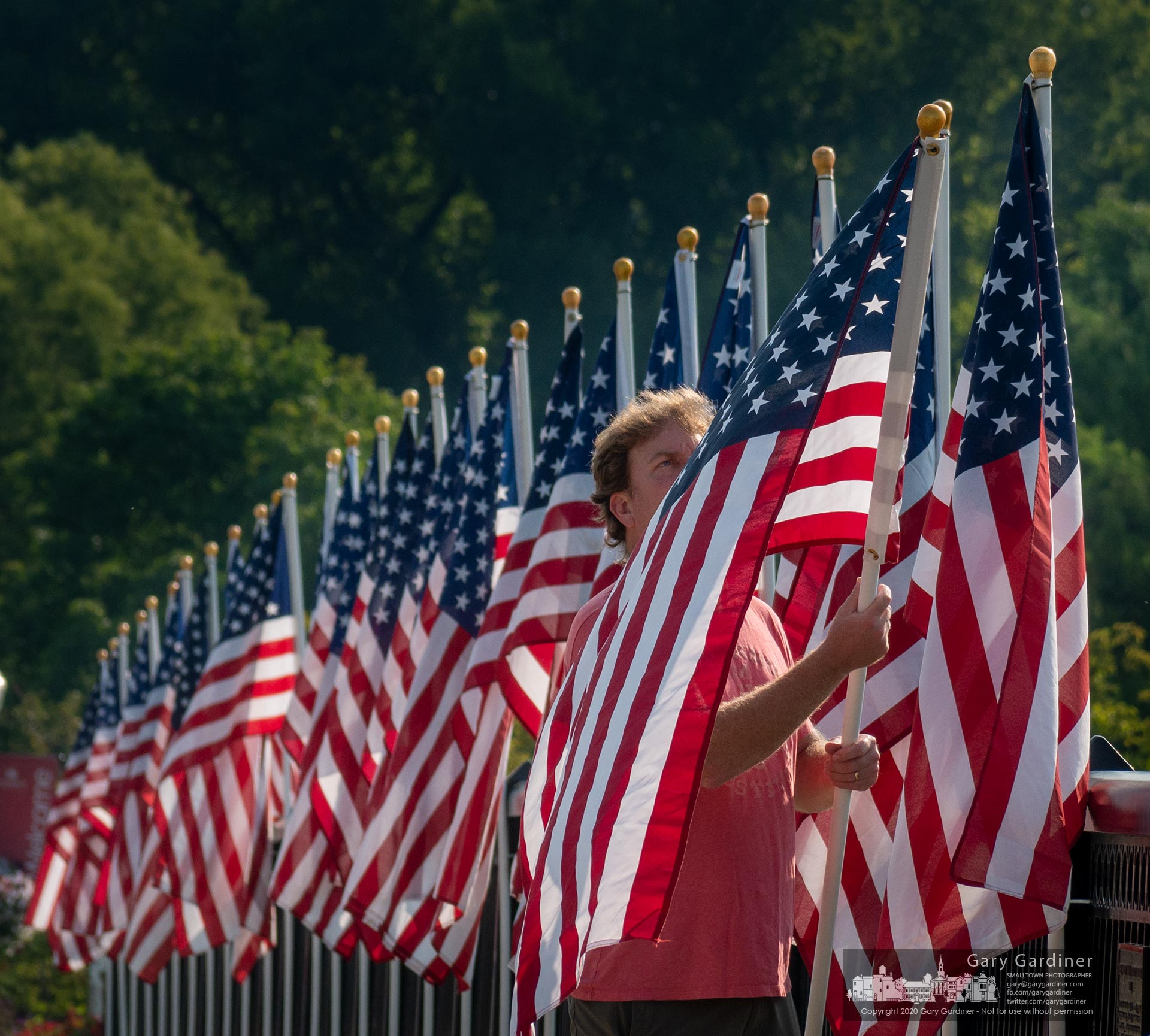 Volunteers place flags along the Main Street bridge sidewalks over Alum Creek marking ceremonies planned for the anniversary of the Sept. 11 terrorist attacks on New York and Washington. My Final Photo for Sept. 9, 2020.