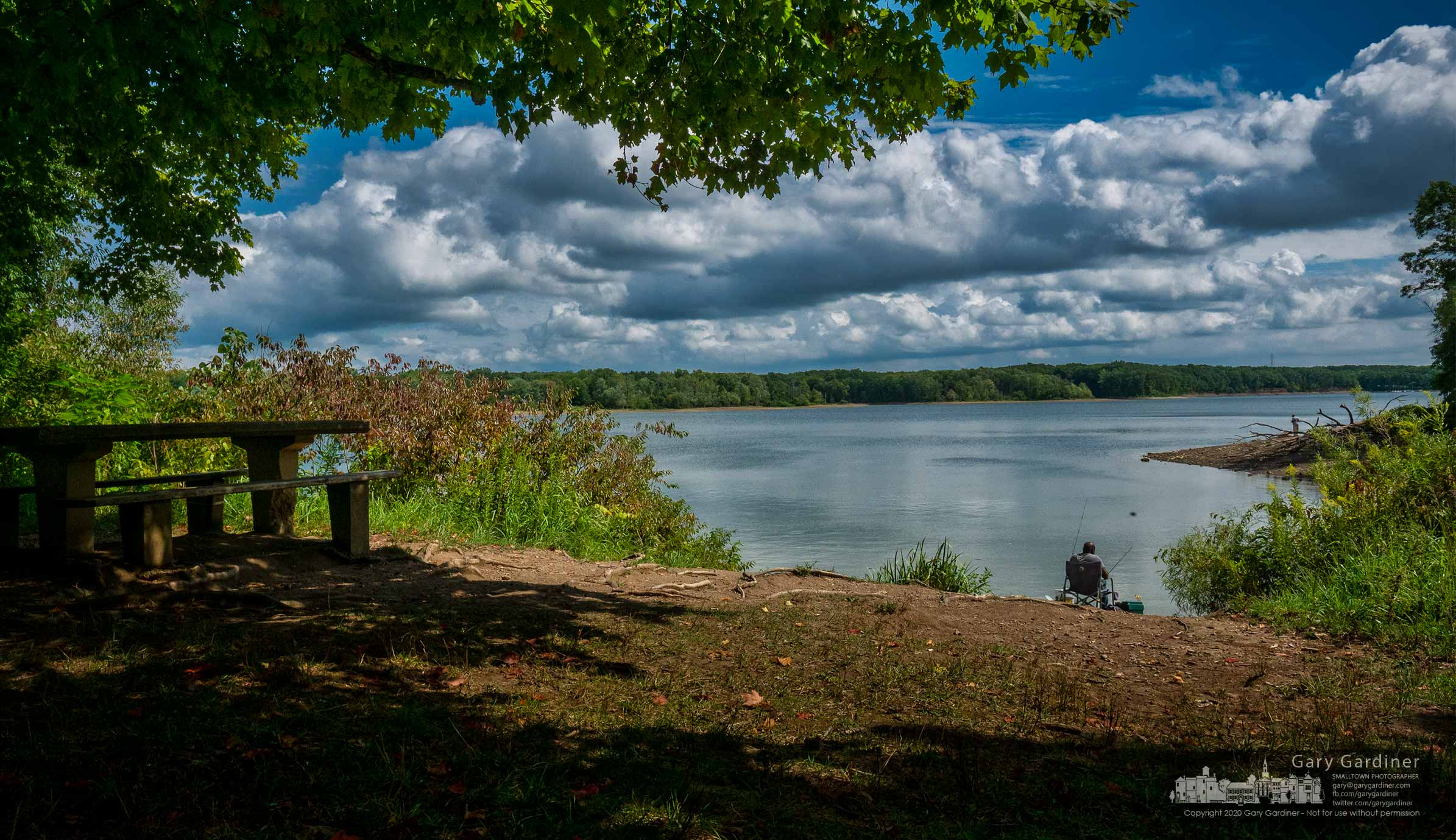 A fisherman rests in a comfortable chair beneath a summer sky on the shoreline of Hoover Reservoir hoping for a little luck at the waters off Red Bank Park. My Final Photo for Sept. 2, 2020.