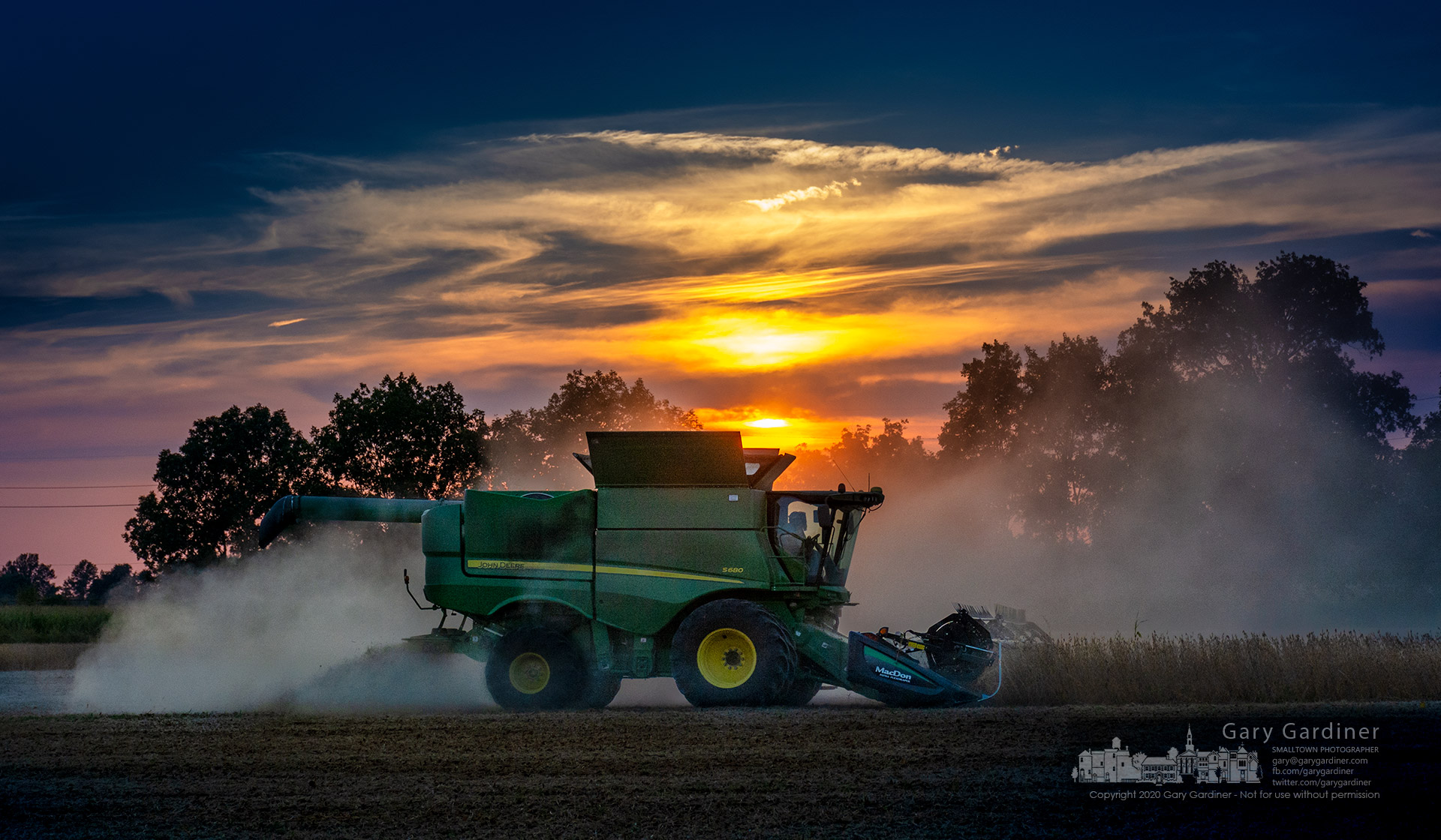 A farmer rushes to beat the sunset and a forecast of rain this week to harvest his soybean fields near Delaware, Ohio. My Final Photo for Sept.27, 2020.