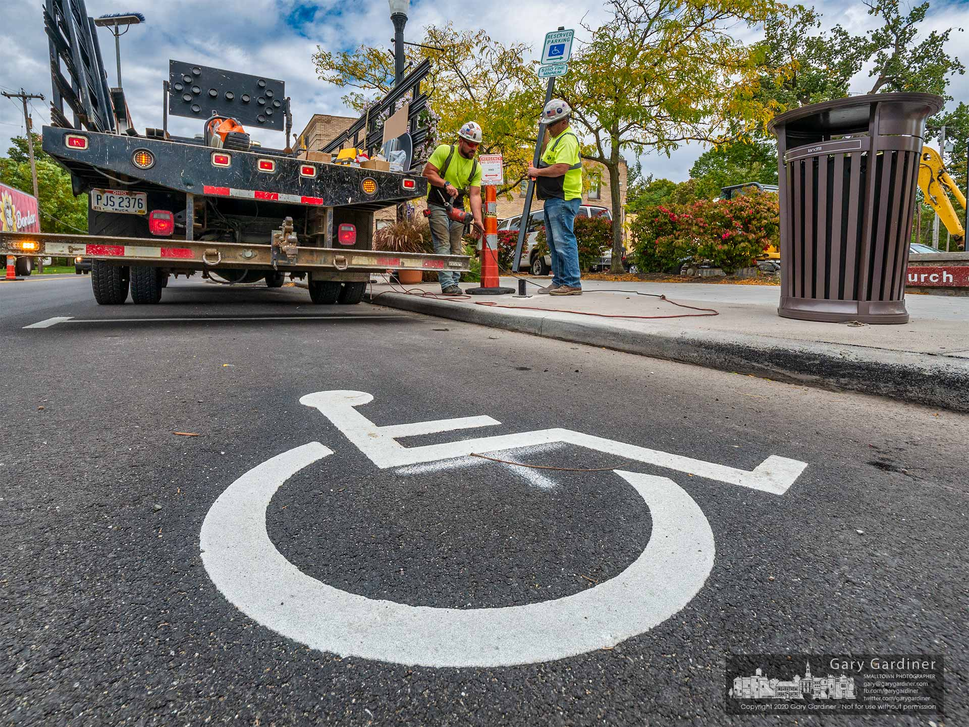 Workers install handicap signs marking the new parking spots in Uptown Westerville following completion of rebuilding the road. My Final Photo for Sept. 30, 2020.