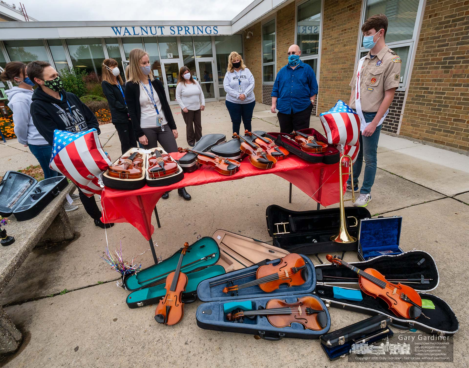 Alex Hendrick, right, is greeted by teachers and staff at Walnut Springs Middle School where he donated 13 musical instruments to the school after he raised the money, purchased old instruments, and had them repaired as part of his Eagle Scout project. My Final Photo for Oct. 28, 2020.
