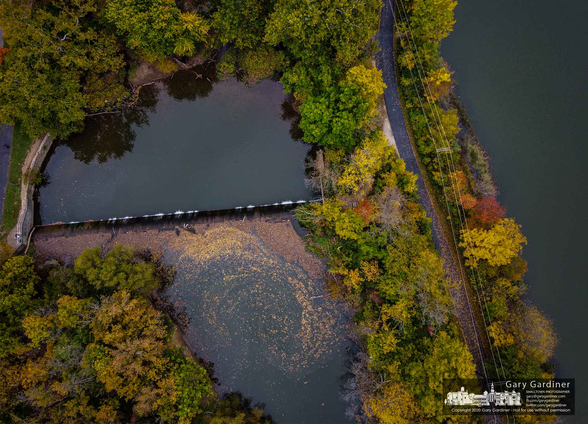 Fall leaves gather in a swirl behind the Alum Creek Park low-head dam as the days get shorter and colder and the creek's water level remains low. My Final Photo for Oct. 10, 2020.