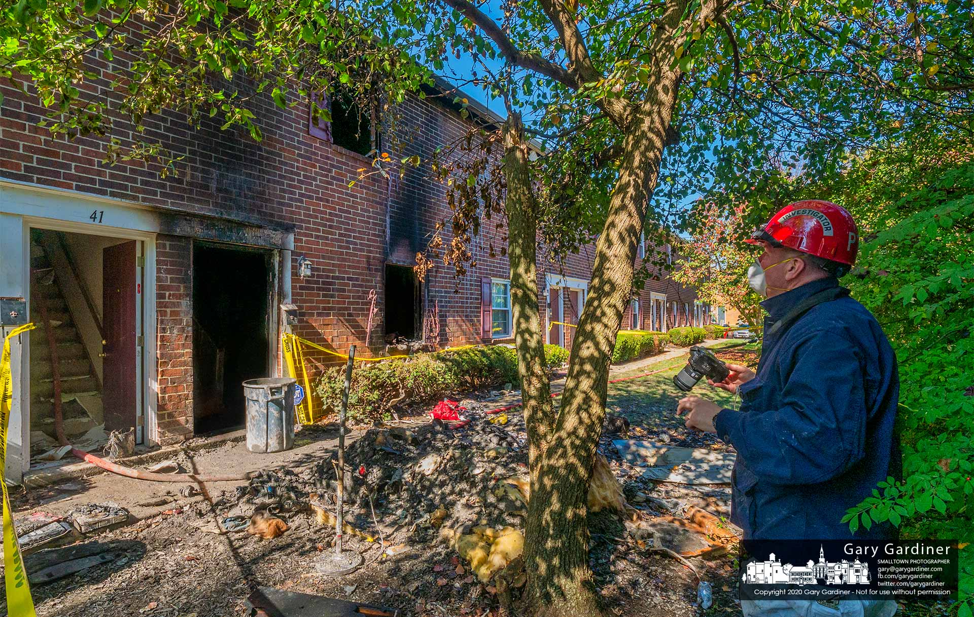 An investigator photographs an apartment complex where one person died in an overnight fire. My Final Photo for Oct. 17, 2020.