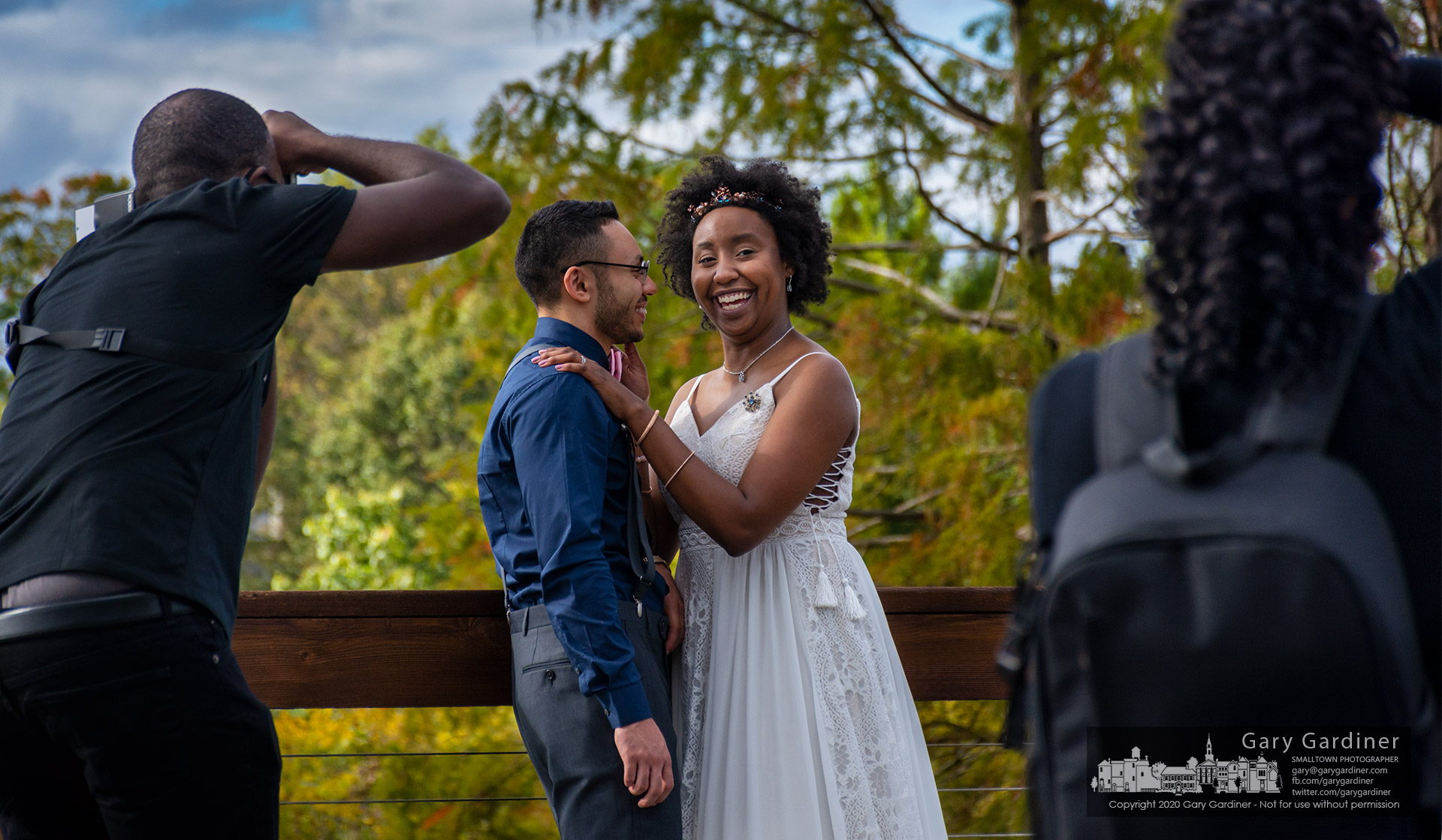 A newly married couple poses for photos along the wooden walkway at the Highlands Park wetlands where they and their families gathered following the afternoon wedding. My Family Photo for Oct. 2, 2020.