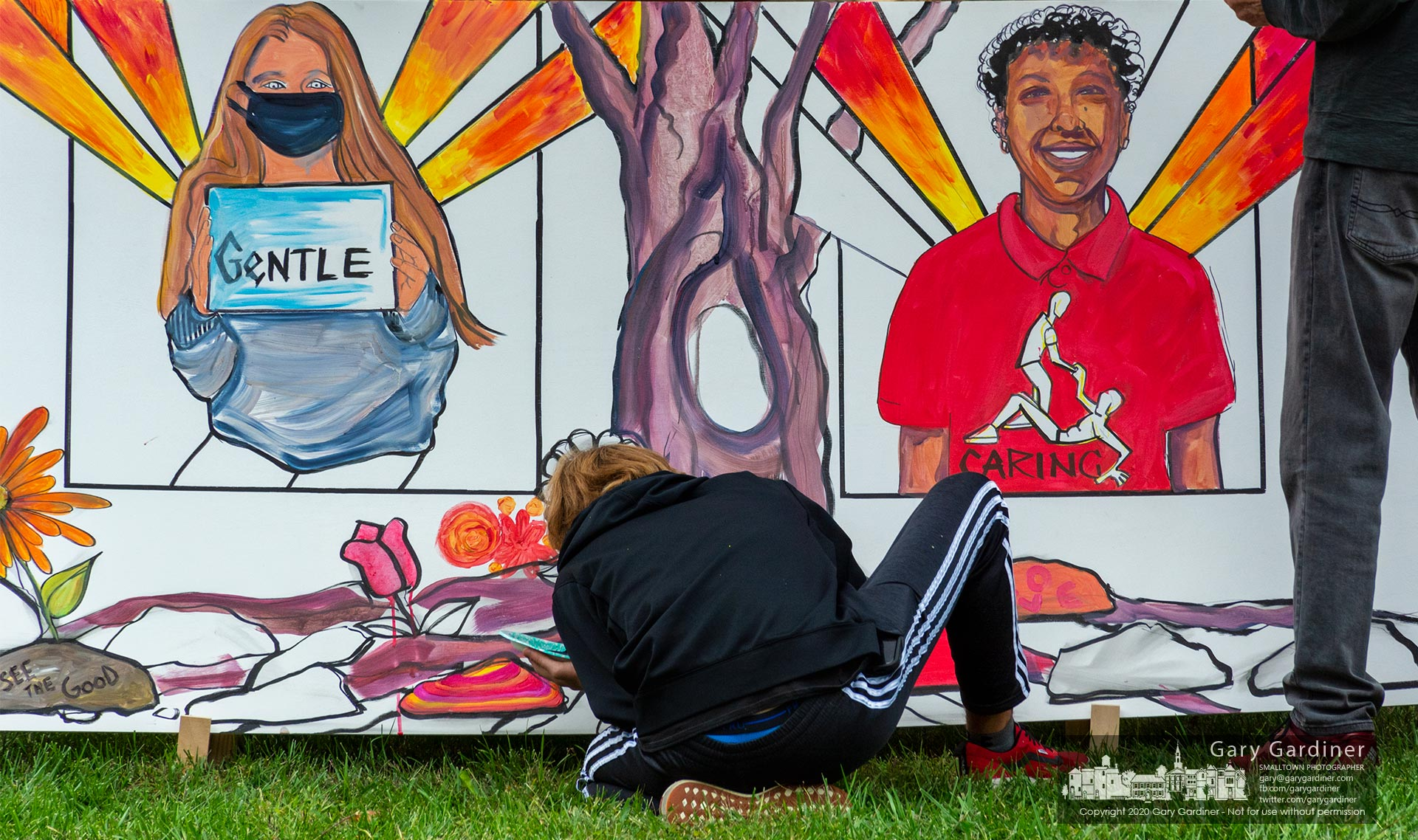 Amateur and more accomplished artists work to create a Kindness Mural at a rally by Neighbor2Neighborhood on the civic green at city hall. My Final Photo for Oct. 4, 2020.
